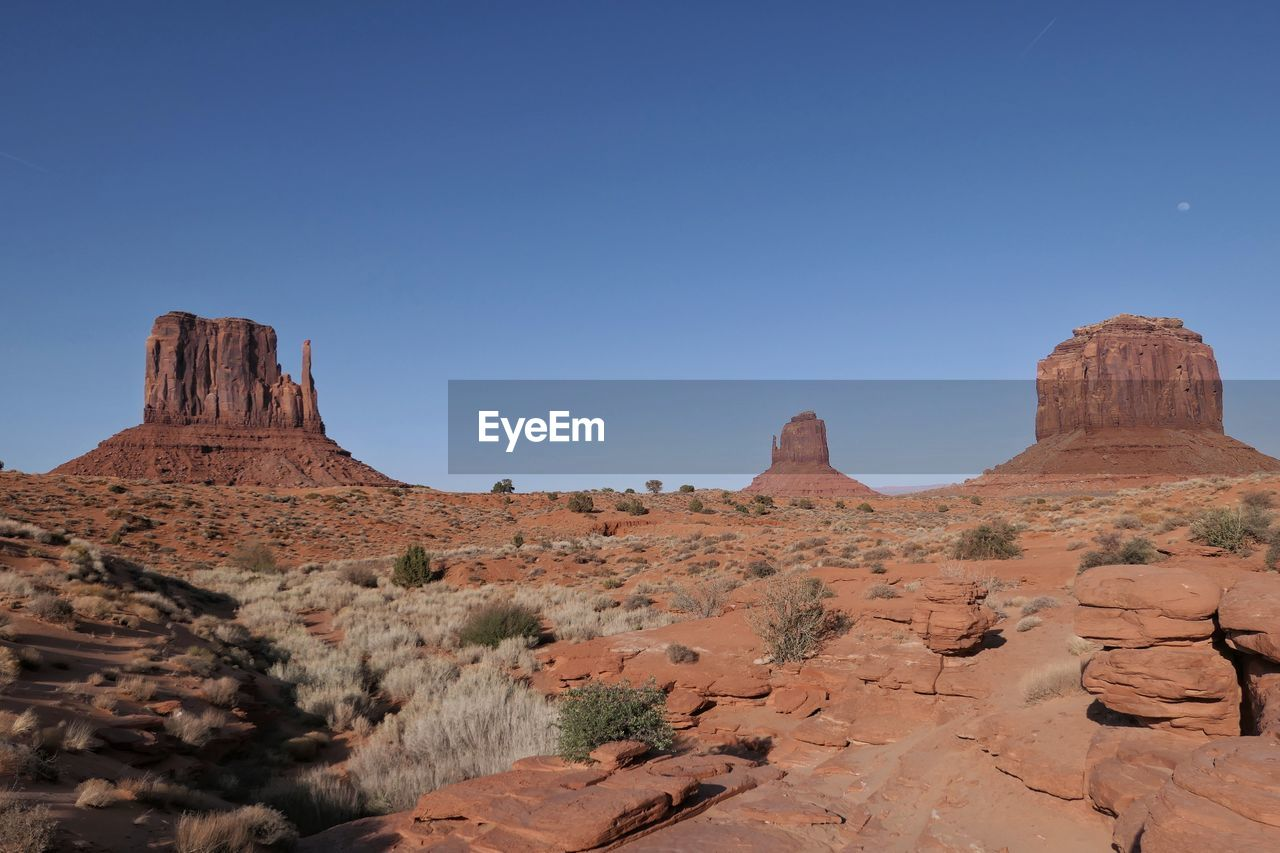 sky, rock formation, rock, rock - object, beauty in nature, tranquil scene, scenics - nature, non-urban scene, solid, tranquility, geology, landscape, physical geography, nature, no people, remote, environment, mountain, travel destinations, land, climate, arid climate, outdoors, formation, eroded, sandstone, mountain peak