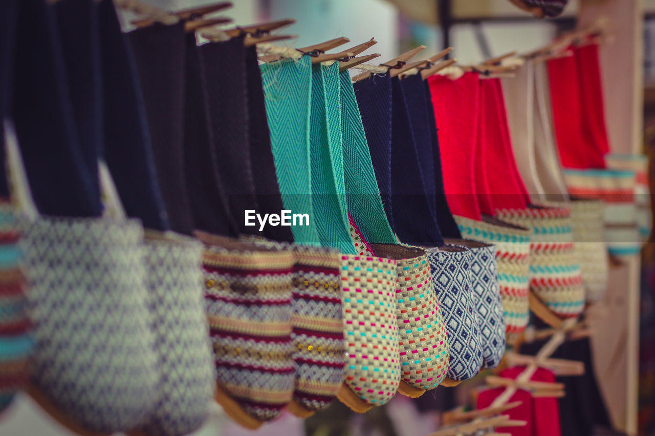 Colorful bags hanging on string