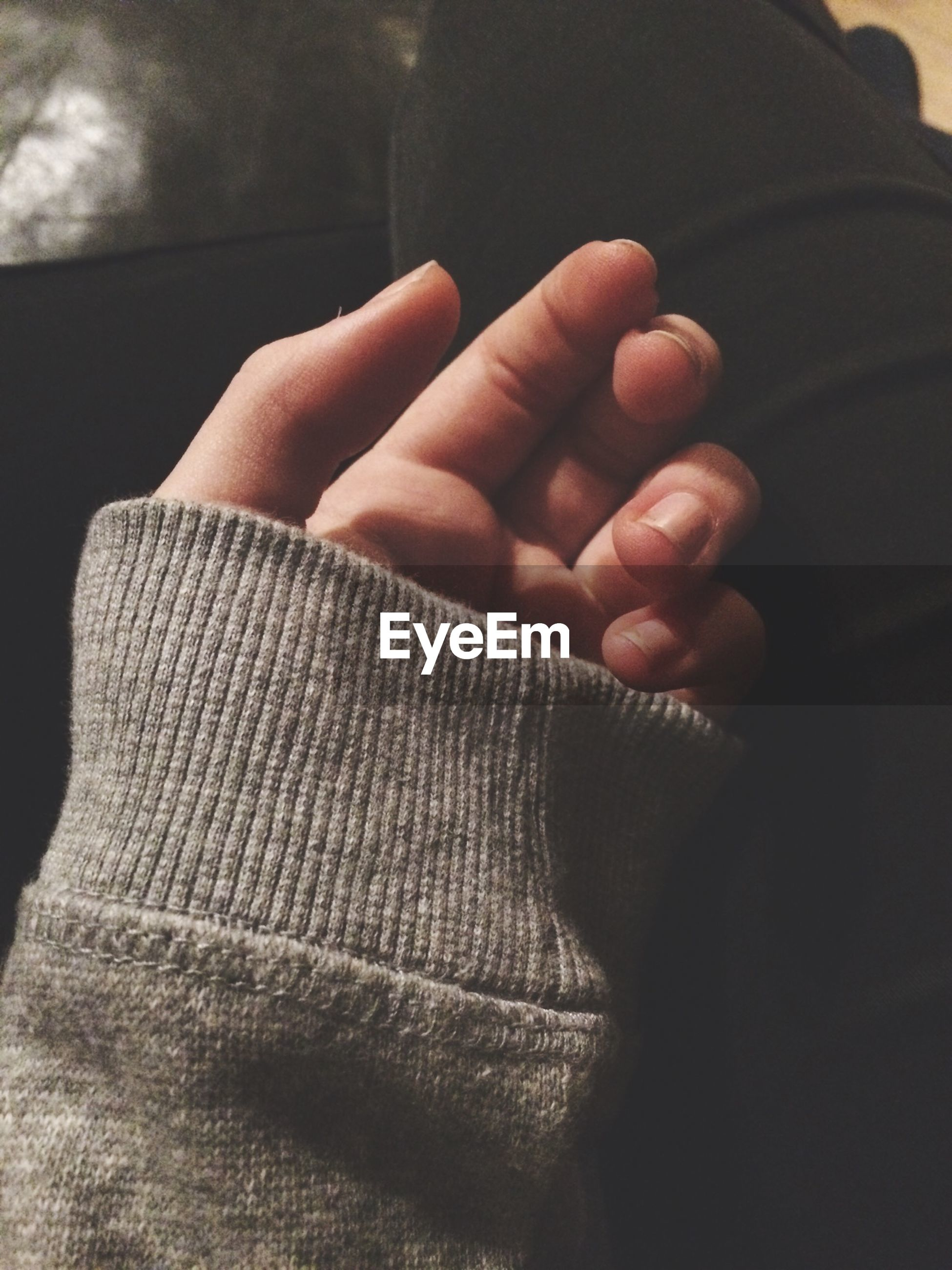 person, part of, lifestyles, indoors, close-up, human finger, personal perspective, leisure activity, cropped, relaxation, men, midsection, bonding, love, low section