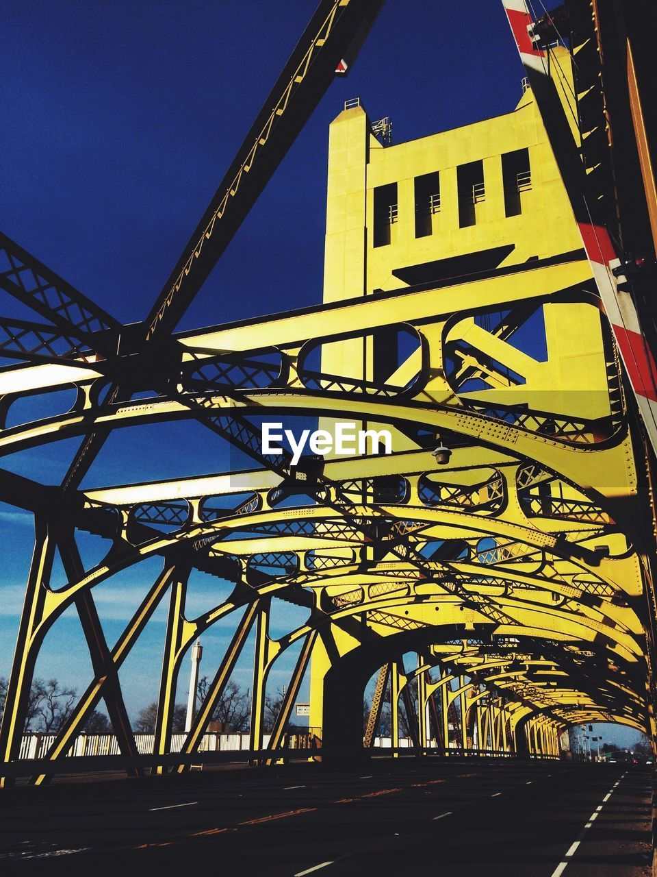 built structure, architecture, outdoors, transportation, low angle view, yellow, day, blue, no people, sky, city
