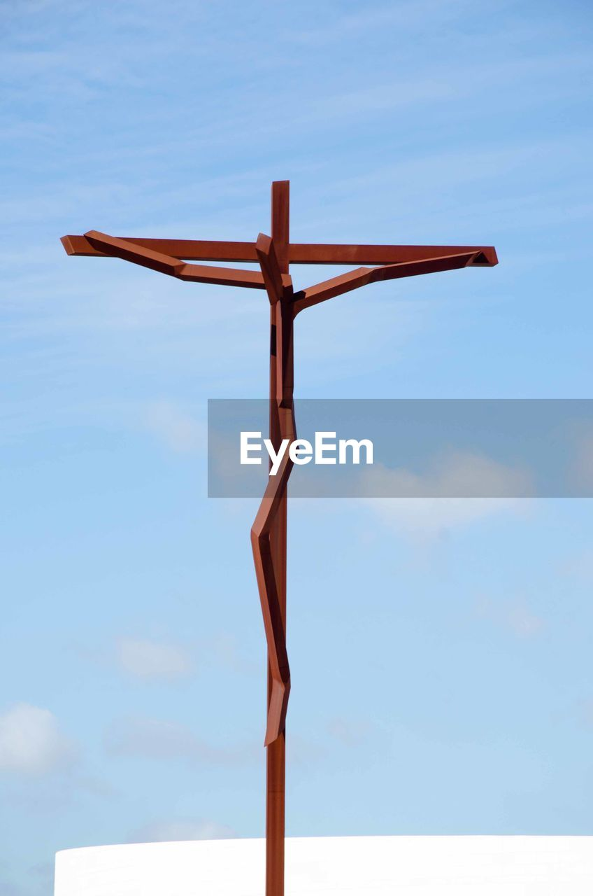 View of wooden crucifix against sky
