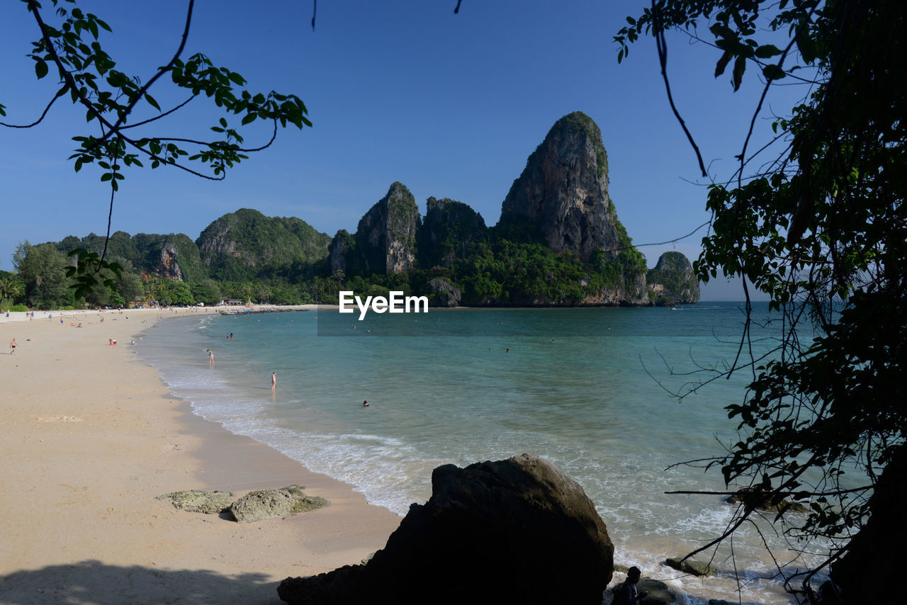 sea, water, nature, tree, rock - object, beauty in nature, scenics, mountain, beach, outdoors, clear sky, tranquility, tranquil scene, blue, sky, no people, day