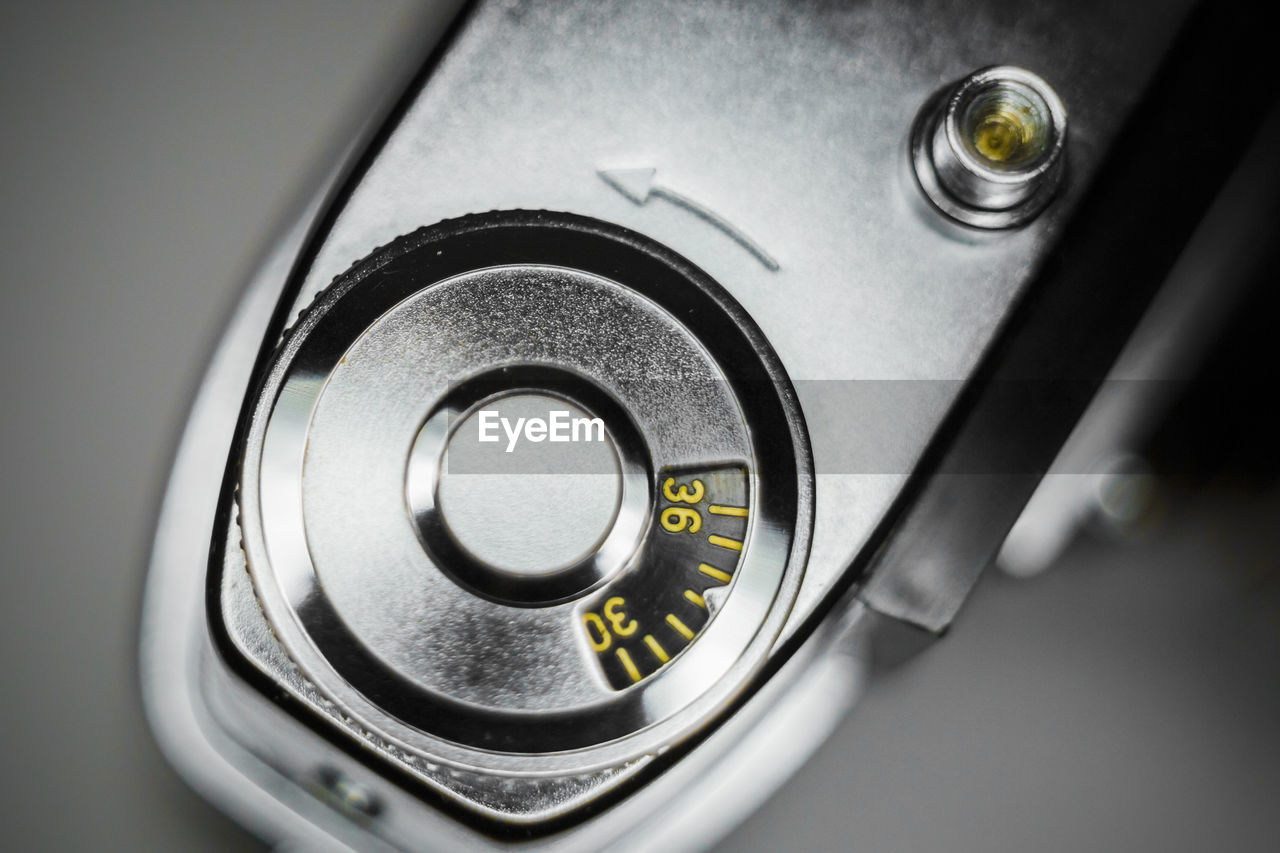 close-up, indoors, technology, no people, music, knob, control, high angle view, arts culture and entertainment, directly above, focus on foreground, metal, still life, push button, communication, food and drink, black color, single object, selective focus, equipment, silver colored, electrical equipment