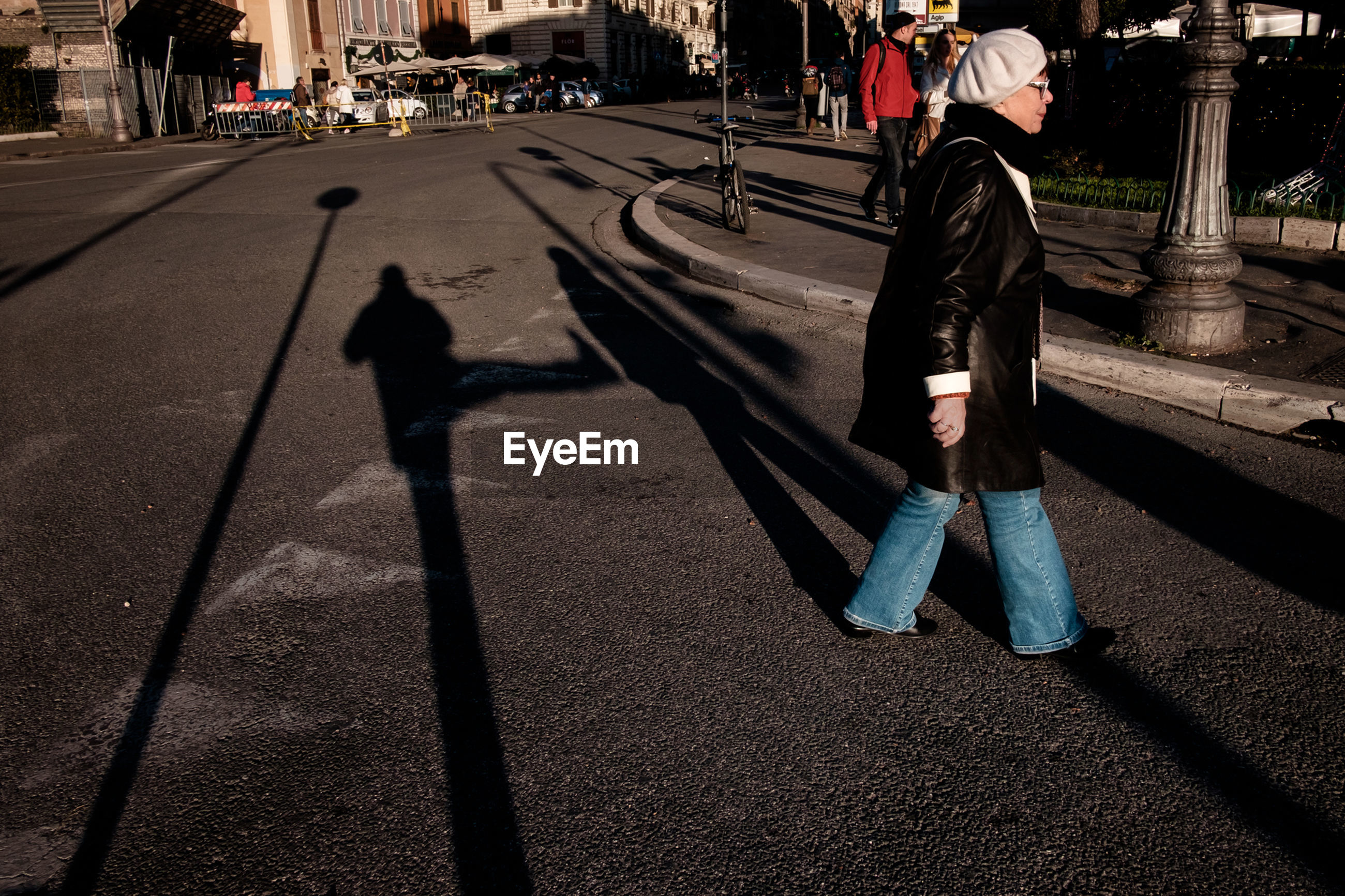 shadow, sunlight, real people, men, outdoors, day, leisure activity, lifestyles, road, full length, one person, city, adult, people