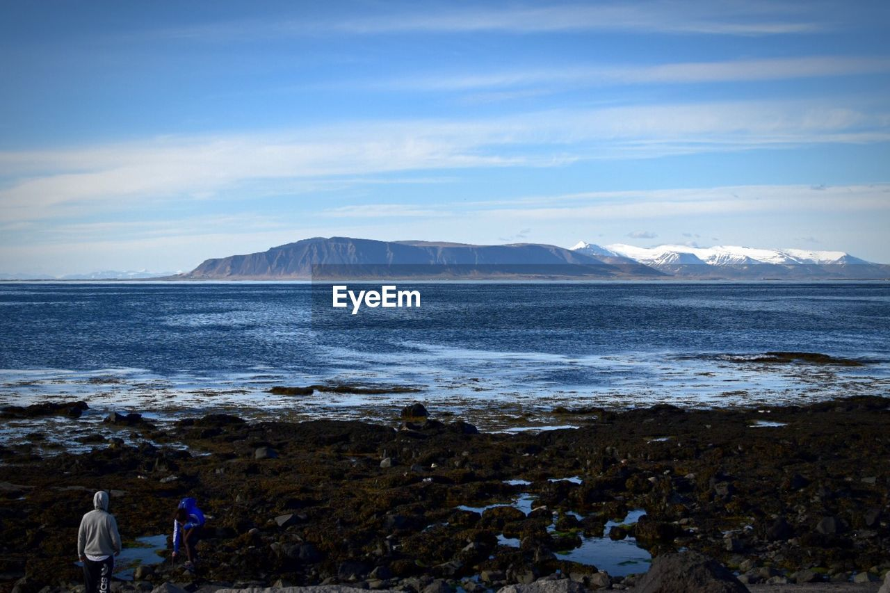 Scenic View Of Snowcapped Mountains By Sea