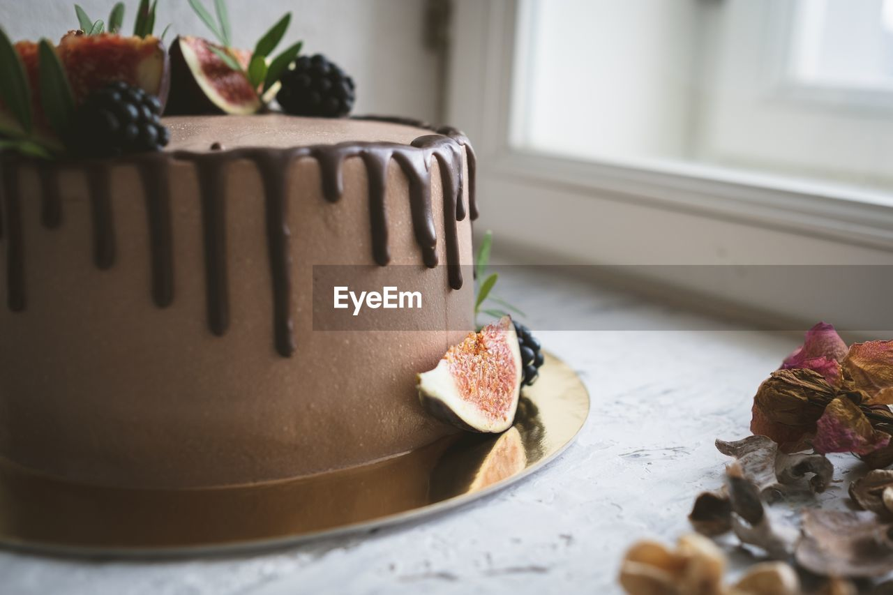 sweet food, dessert, sweet, food, food and drink, indoors, cake, indulgence, baked, freshness, still life, temptation, table, no people, unhealthy eating, fruit, ready-to-eat, close-up, selective focus, plate, snack, chocolate cake
