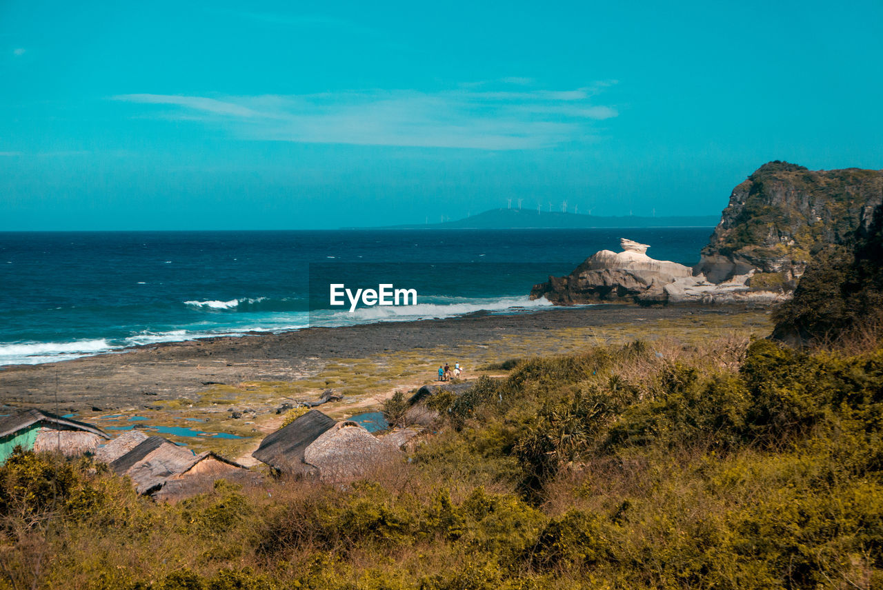 sea, water, sky, land, scenics - nature, beach, horizon, horizon over water, beauty in nature, tranquil scene, nature, rock, tranquility, blue, day, no people, rock - object, solid, non-urban scene, outdoors