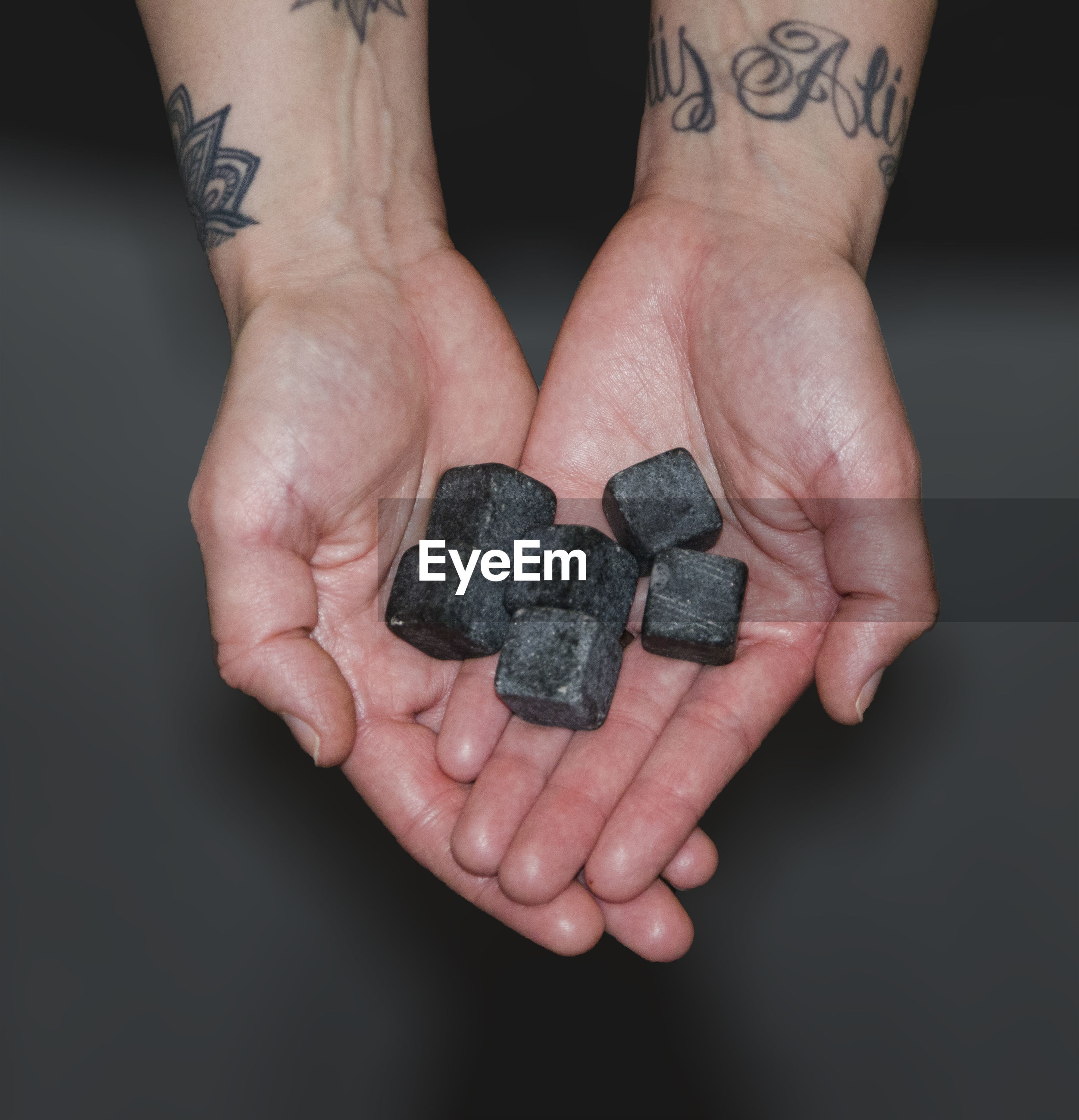 Close-up of human hand holding rocks
