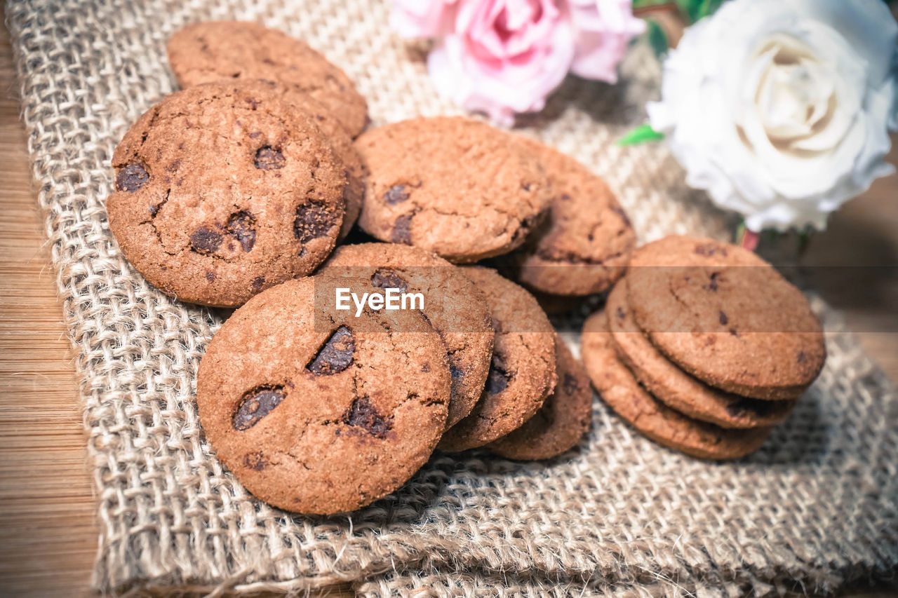 food and drink, food, sweet food, indulgence, freshness, baked, temptation, no people, close-up, cookie, indoors, chocolate, table, still life, ready-to-eat, dessert, focus on foreground, sweet, homemade, high angle view, snack, chocolate chip cookie
