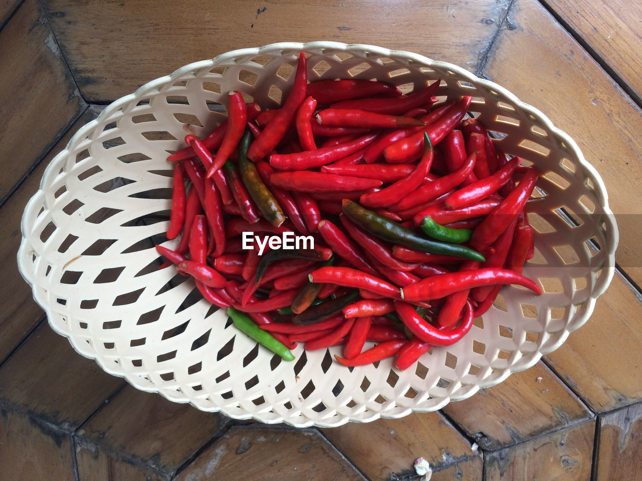 High angle view of chili peppers in bowl on table
