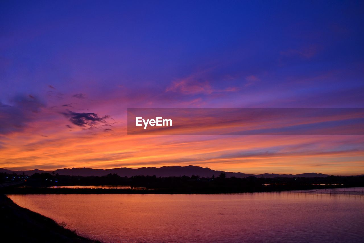 View Of Lake Against Sky During Sunset