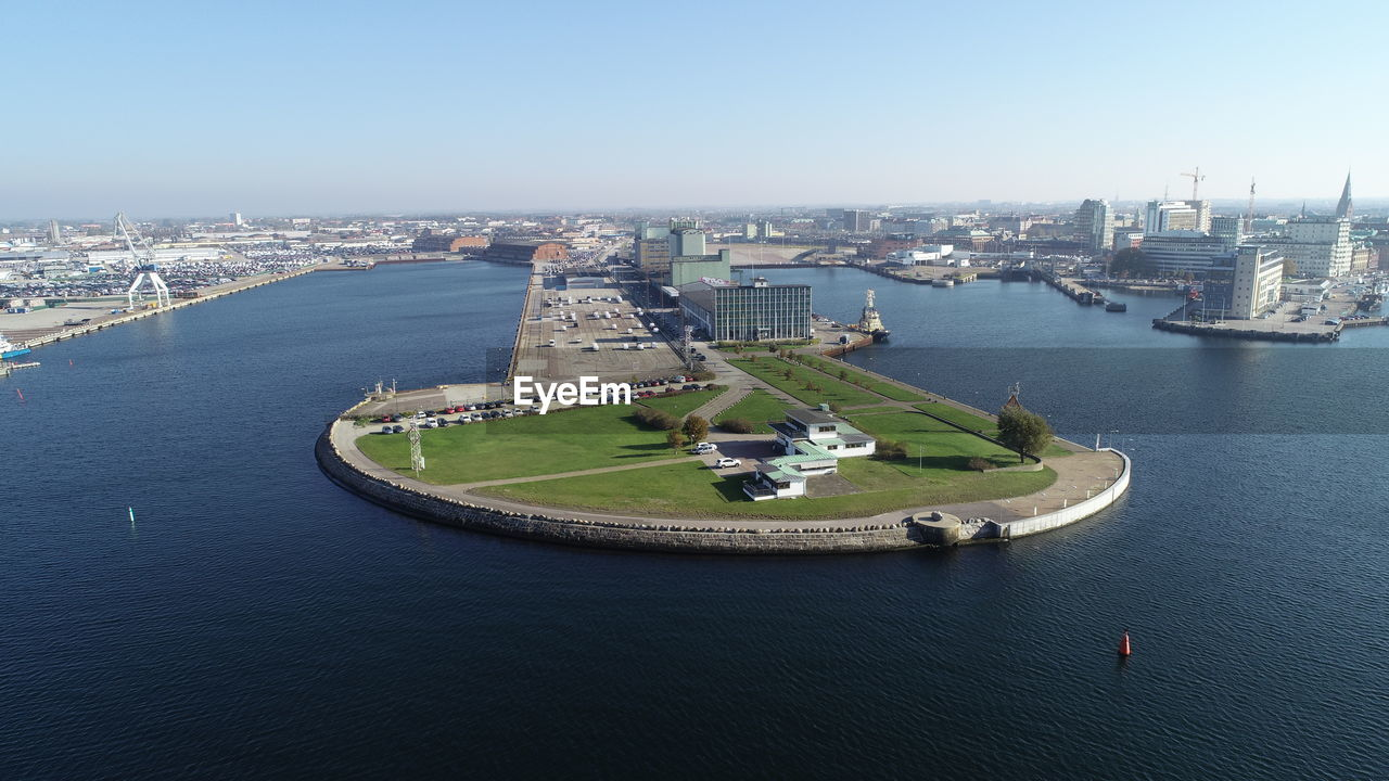 architecture, building exterior, built structure, city, water, transportation, cityscape, nature, river, high angle view, sky, building, day, travel destinations, no people, connection, travel, waterfront, nautical vessel, outdoors, office building exterior, skyscraper