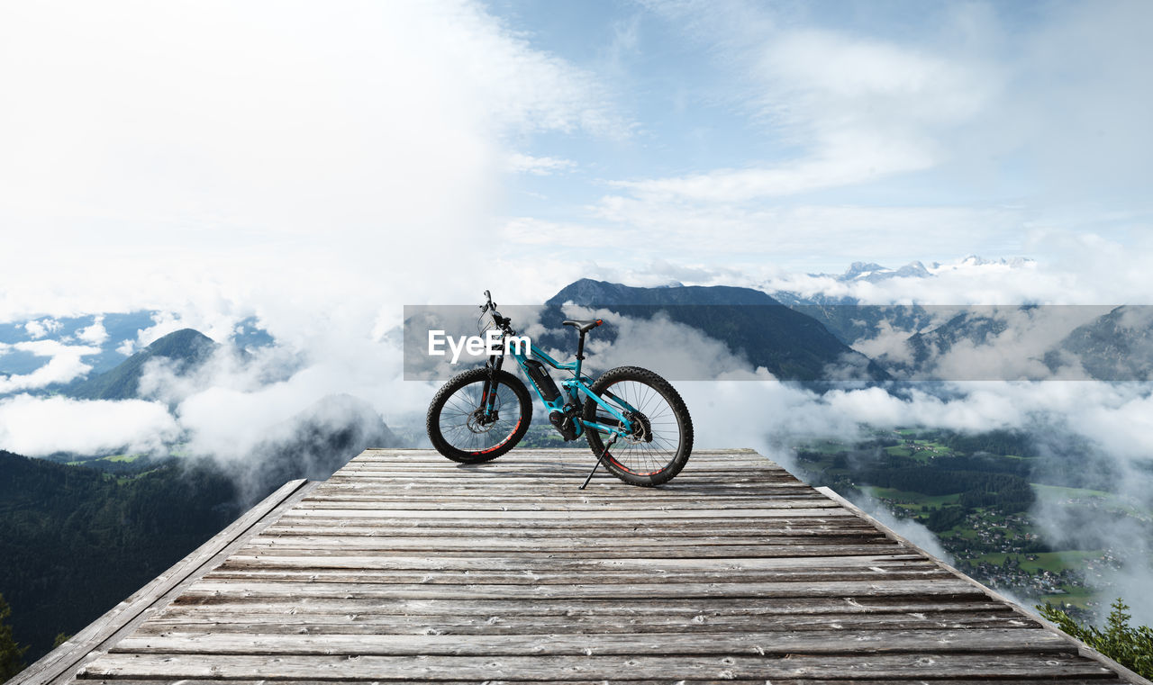 BICYCLE AGAINST MOUNTAIN