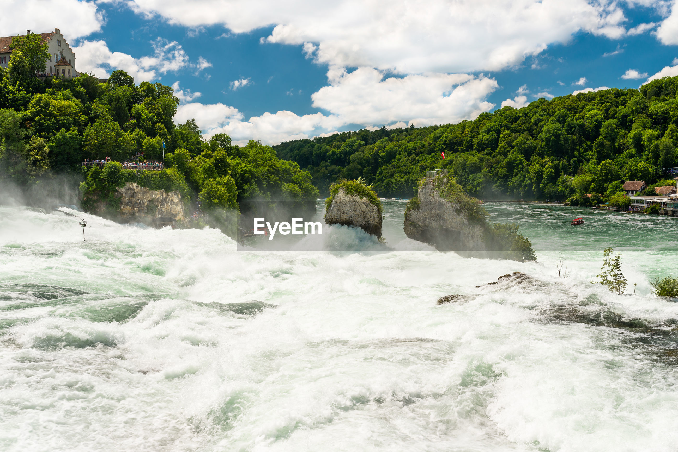 Beautiful, turquoise rhine river flowing from a waterfall in northern switzerland.