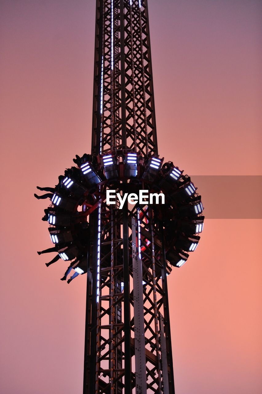 sky, amusement park ride, amusement park, low angle view, architecture, tall - high, built structure, arts culture and entertainment, clear sky, nature, sunset, metal, tower, no people, enjoyment, orange color, outdoors, fun, ride, dusk, fairground, excitement