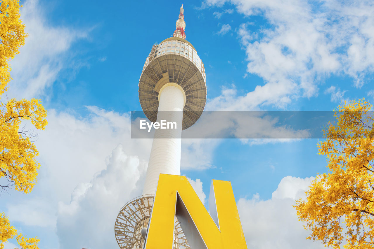 yellow, sky, cloud - sky, low angle view, architecture, day, built structure, outdoors, no people, building exterior, tree