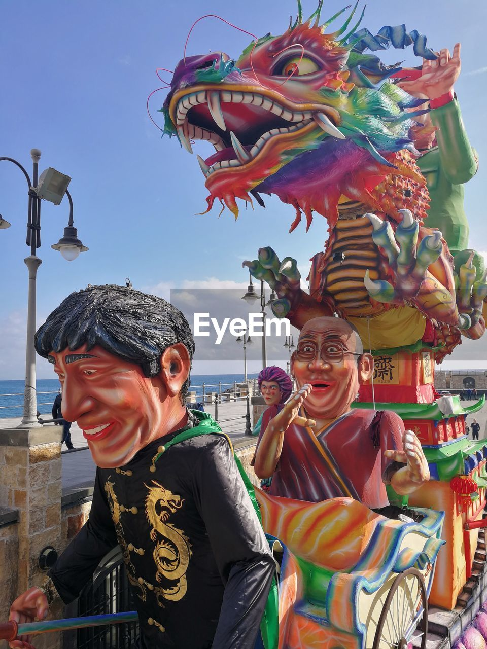 representation, art and craft, creativity, multi colored, lifestyles, real people, sculpture, statue, arts culture and entertainment, human representation, architecture, leisure activity, day, people, men, outdoors, built structure, festival
