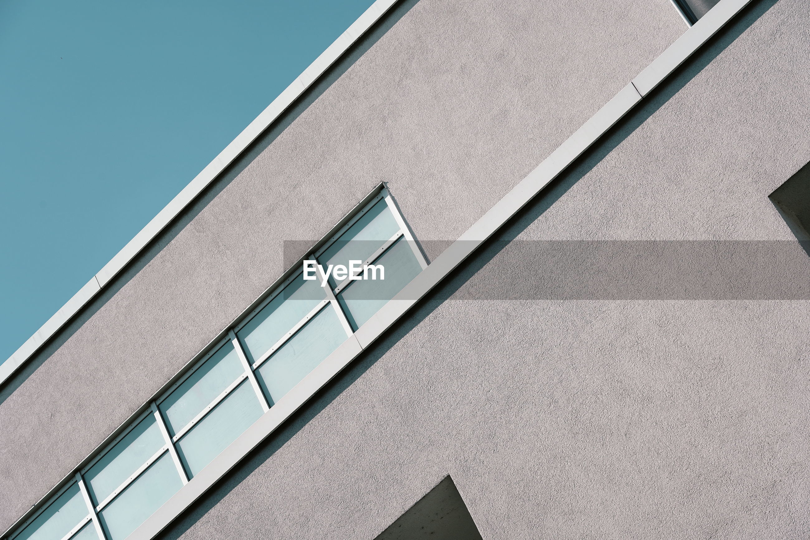 architecture, built structure, building exterior, low angle view, building, no people, facade, line, daylighting, clear sky, sky, window, office, city, day, business, outdoors, pattern, nature, blue, sunlight, wall - building feature, gray, sparse