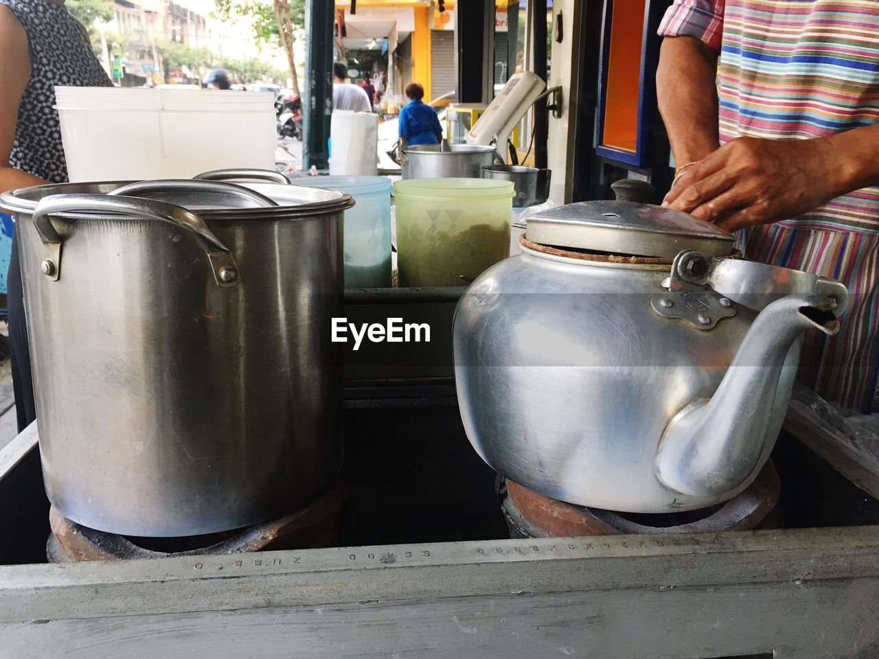 Midsection Of Man Selling Tea