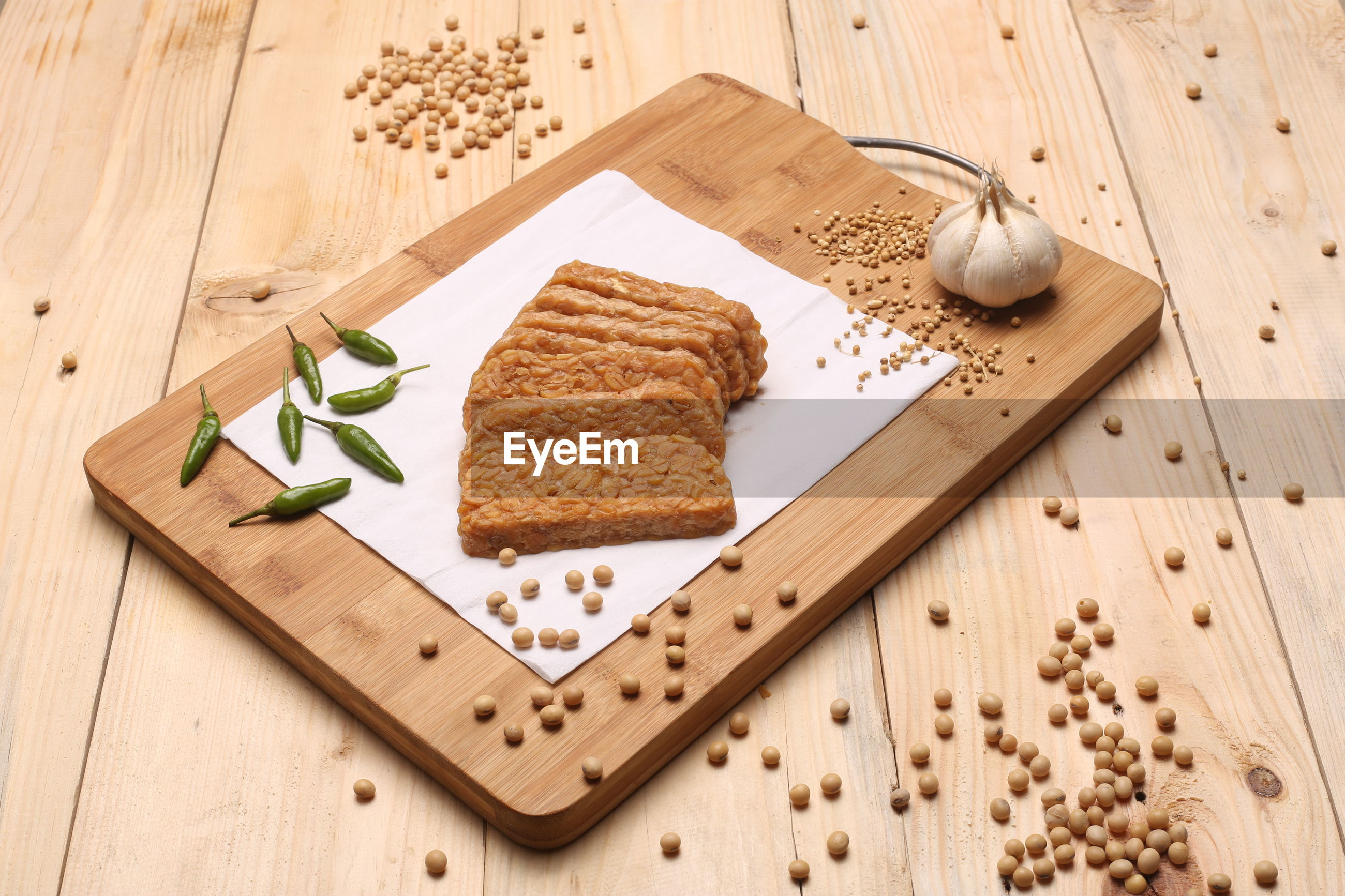 Close-up of food and ingredients on wooden table