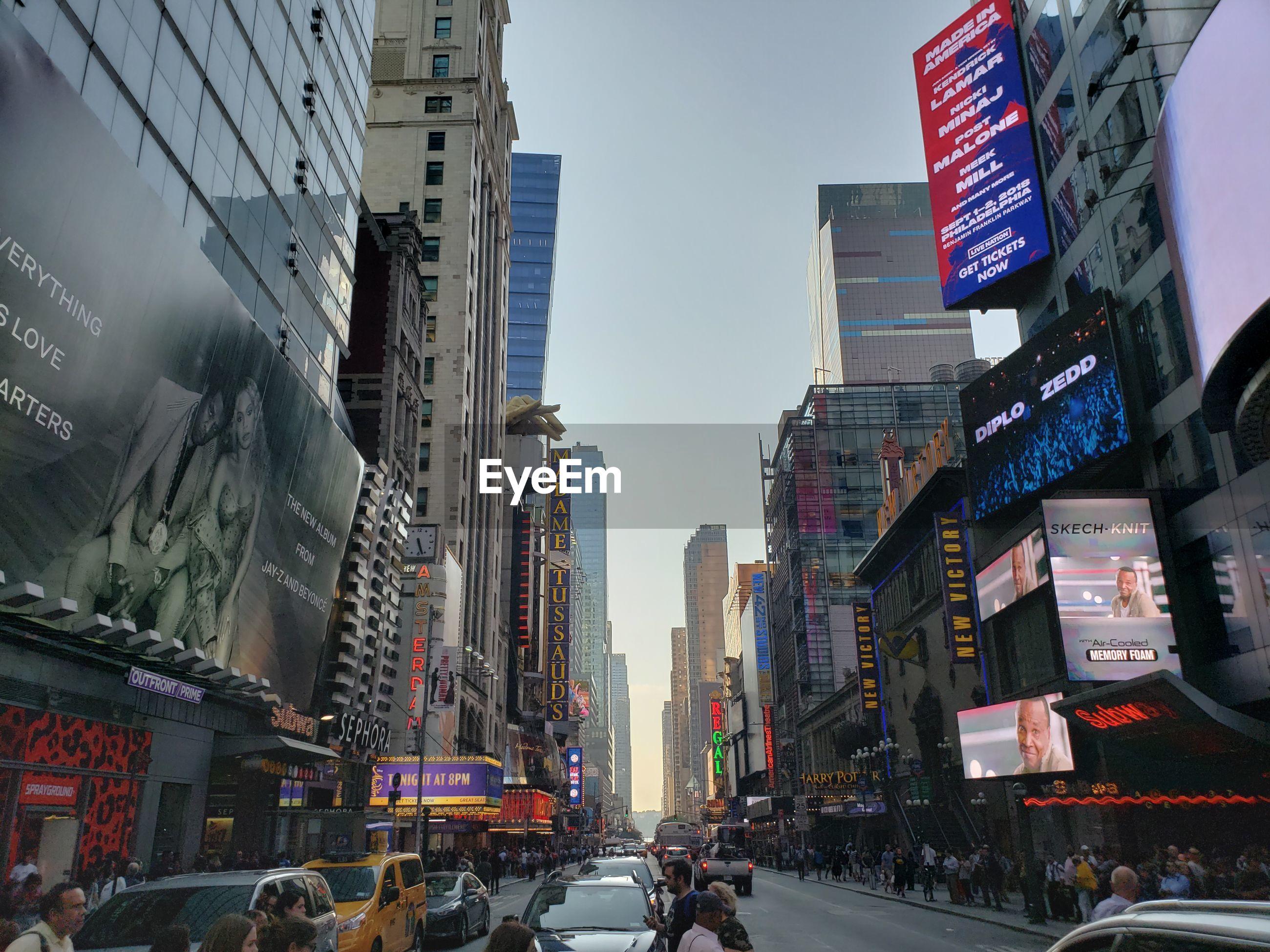 City street and modern buildings against sky