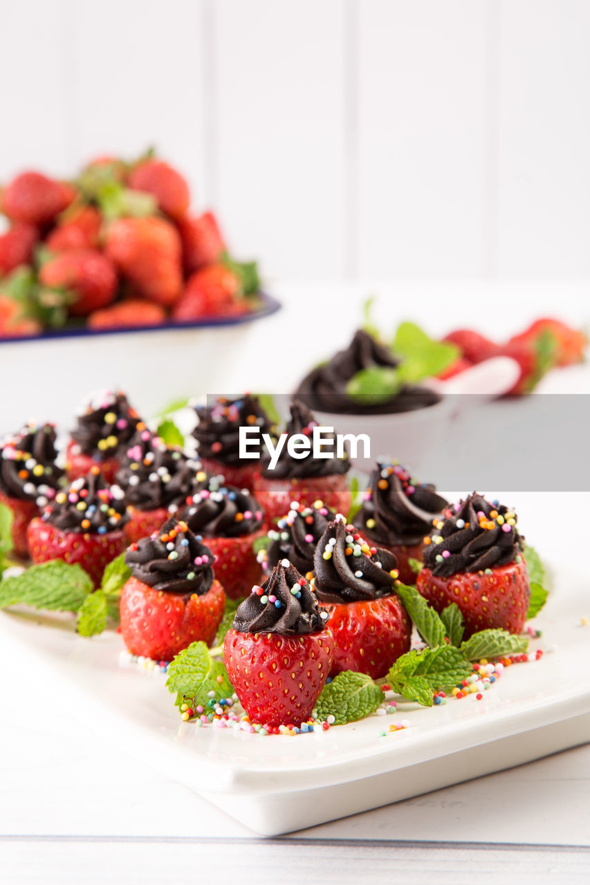 food, berry fruit, fruit, healthy eating, food and drink, freshness, strawberry, table, still life, focus on foreground, indoors, wellbeing, plate, indulgence, sweet food, dessert, sweet, ready-to-eat, no people, close-up, temptation, ripe