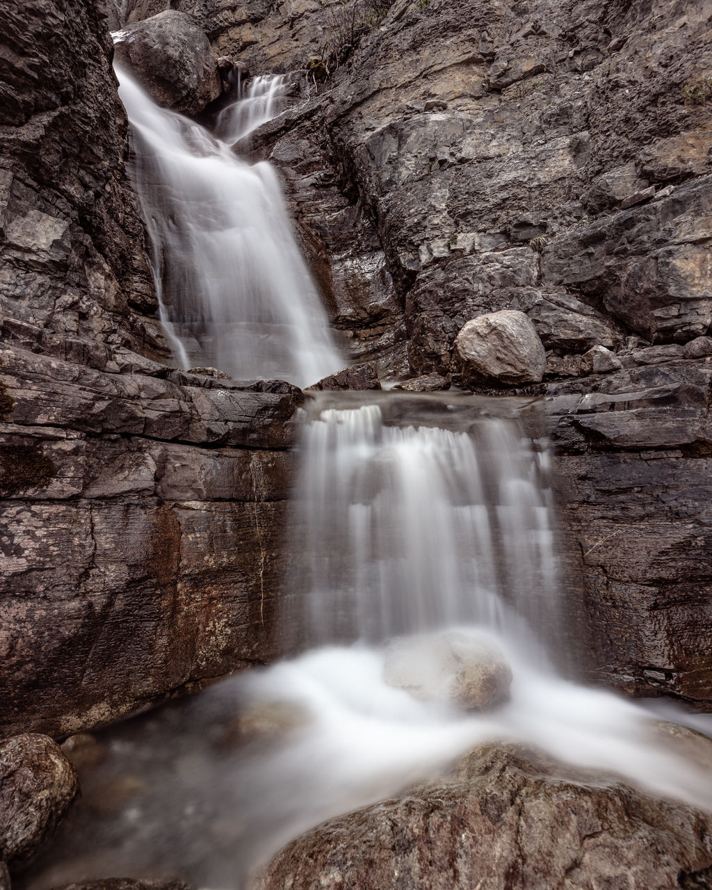 long exposure, waterfall, scenics - nature, rock, flowing water, motion, water, rock - object, blurred motion, beauty in nature, solid, rock formation, nature, no people, flowing, day, land, environment, non-urban scene, falling water, outdoors, power in nature, purity