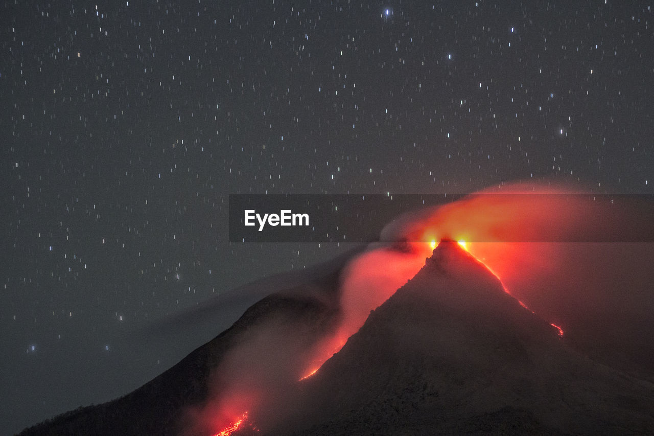 Scenic View Of Volcanic Crater Against Star Field At Night
