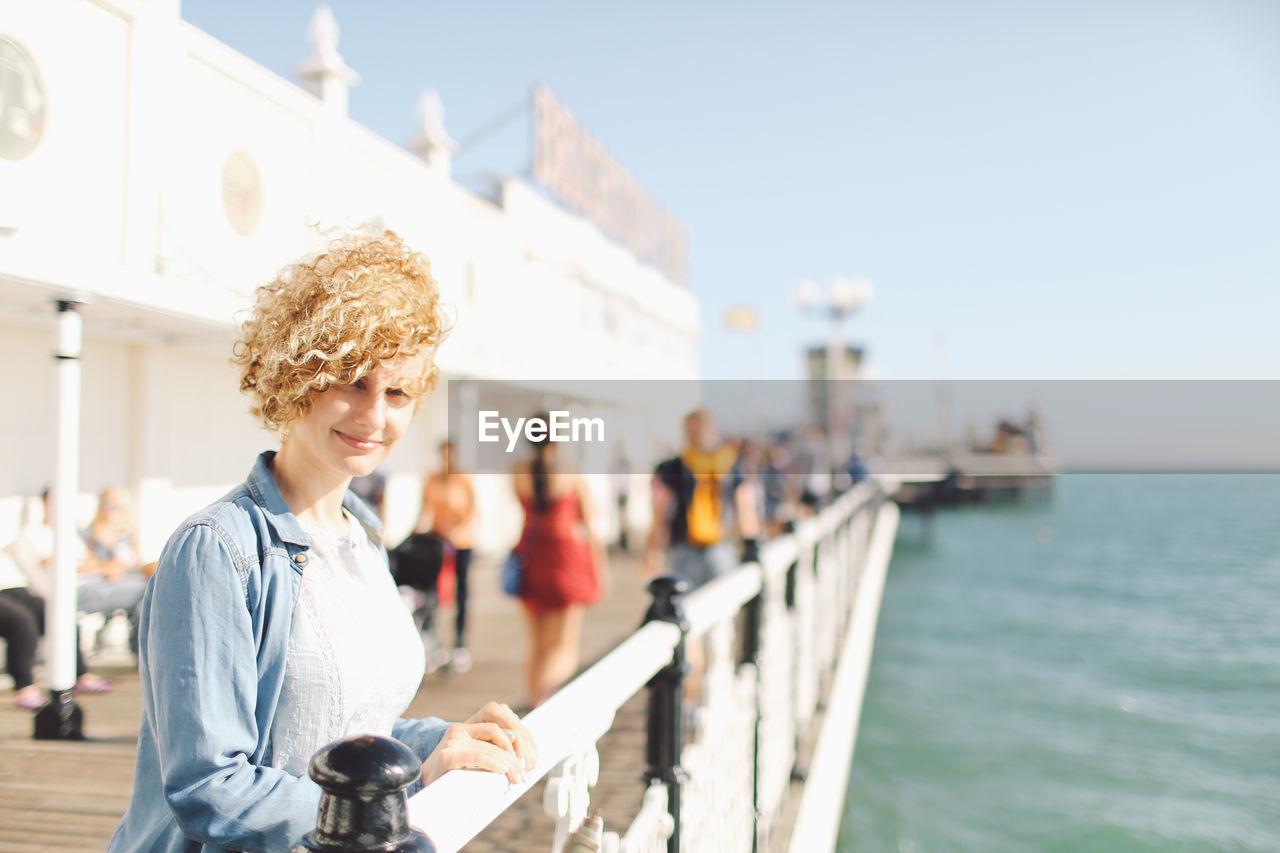 Portrait Of Woman At Brighton Pier Against Sky