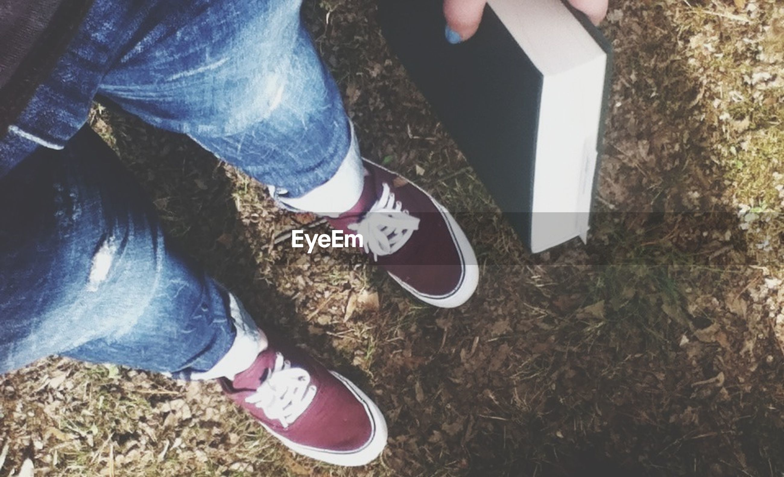 low section, person, shoe, lifestyles, text, footwear, high angle view, personal perspective, standing, leisure activity, human foot, western script, canvas shoe, communication, day, field, men