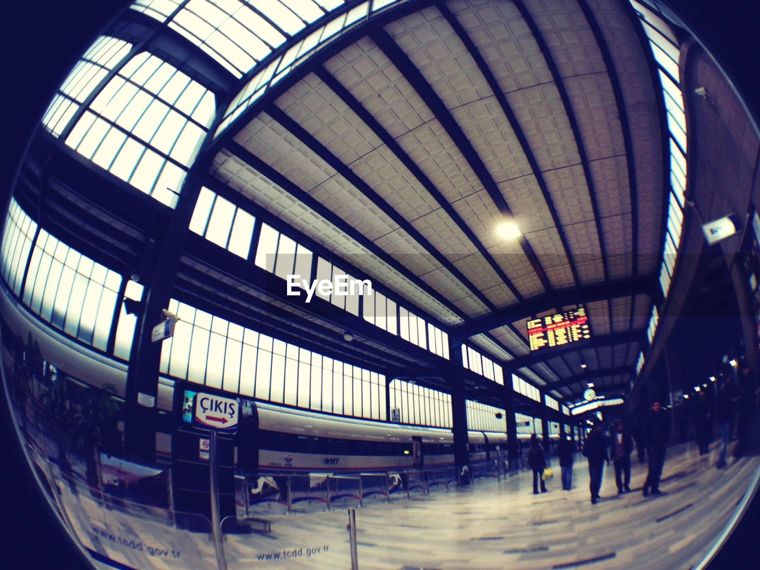 indoors, transportation, mode of transport, architecture, built structure, public transportation, illuminated, ceiling, railroad station, glass - material, travel, airport, interior, incidental people, text, train - vehicle, night, low angle view, window, modern