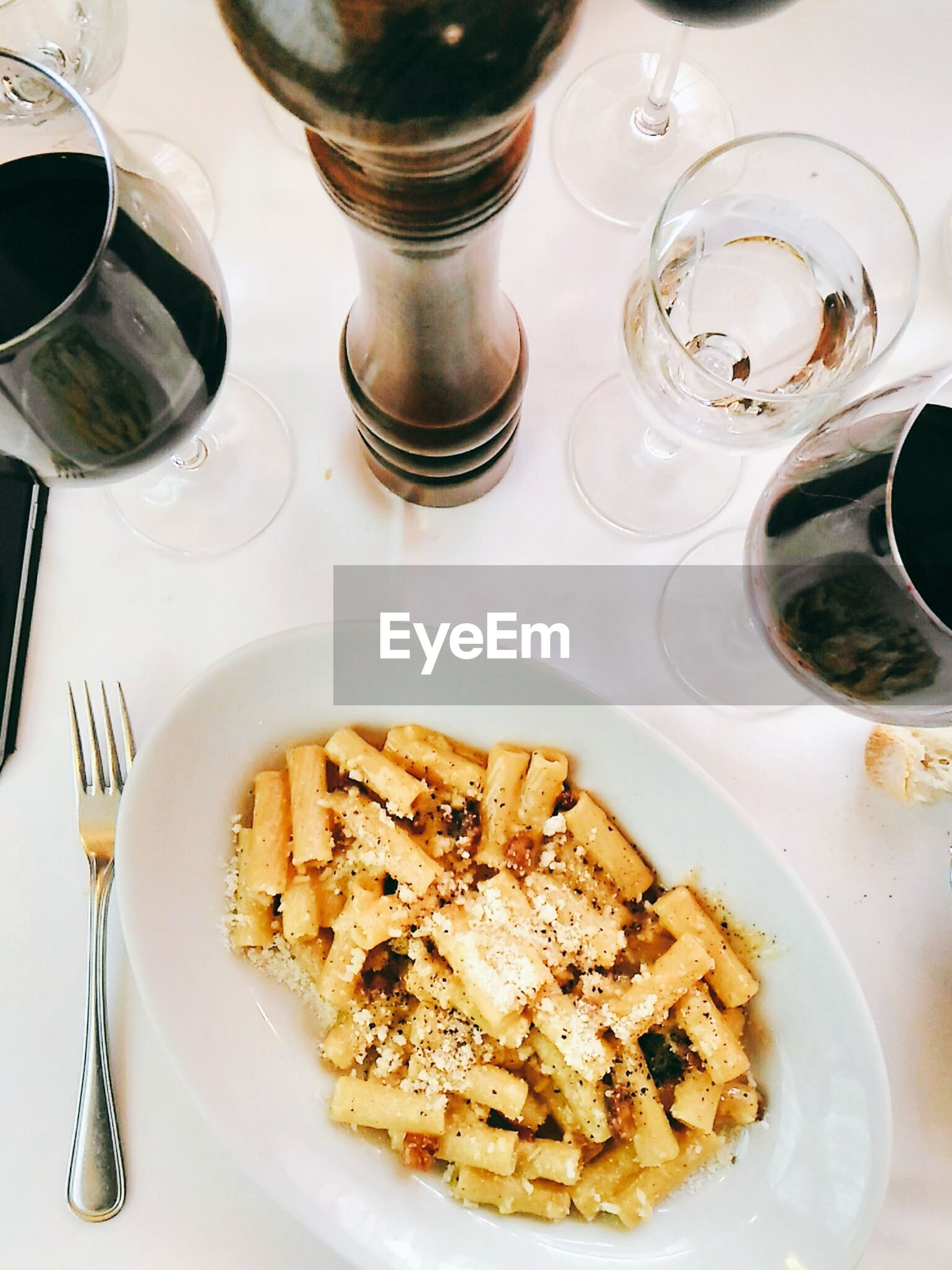 Top view of pasta with wine glass