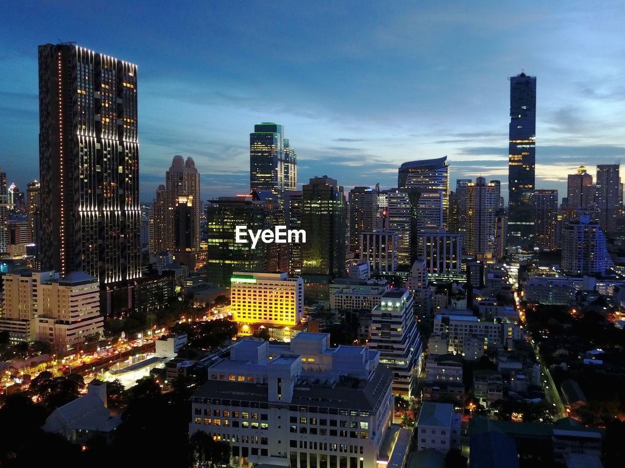 Illuminated Cityscape Against Sky