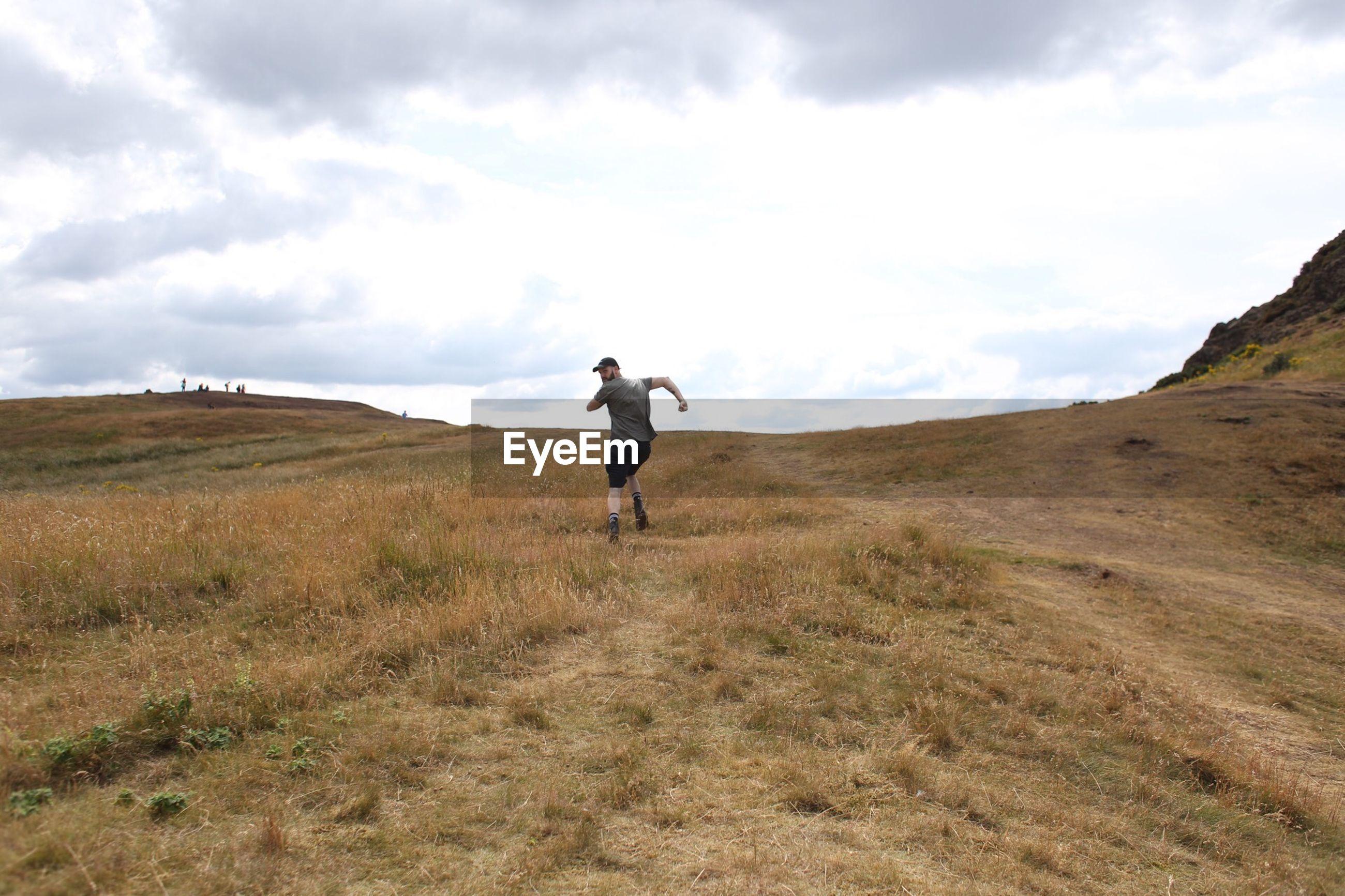 FULL LENGTH OF MAN ON FIELD