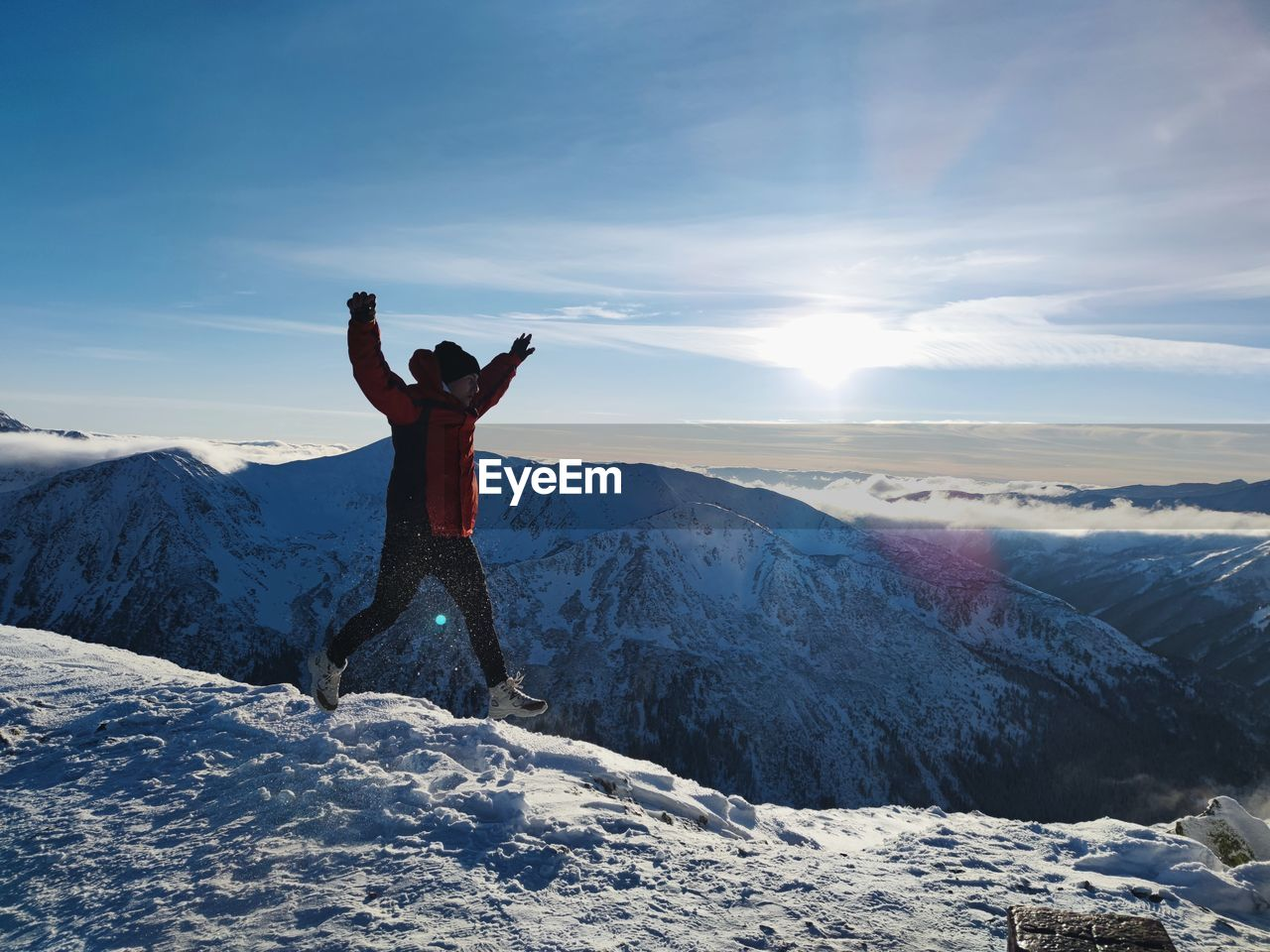 Full length of man man walking on snow against sky during winter