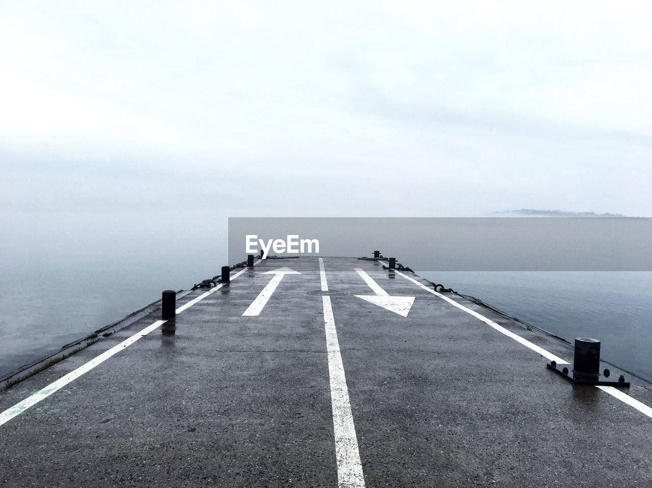 Empty Road Along Ocean