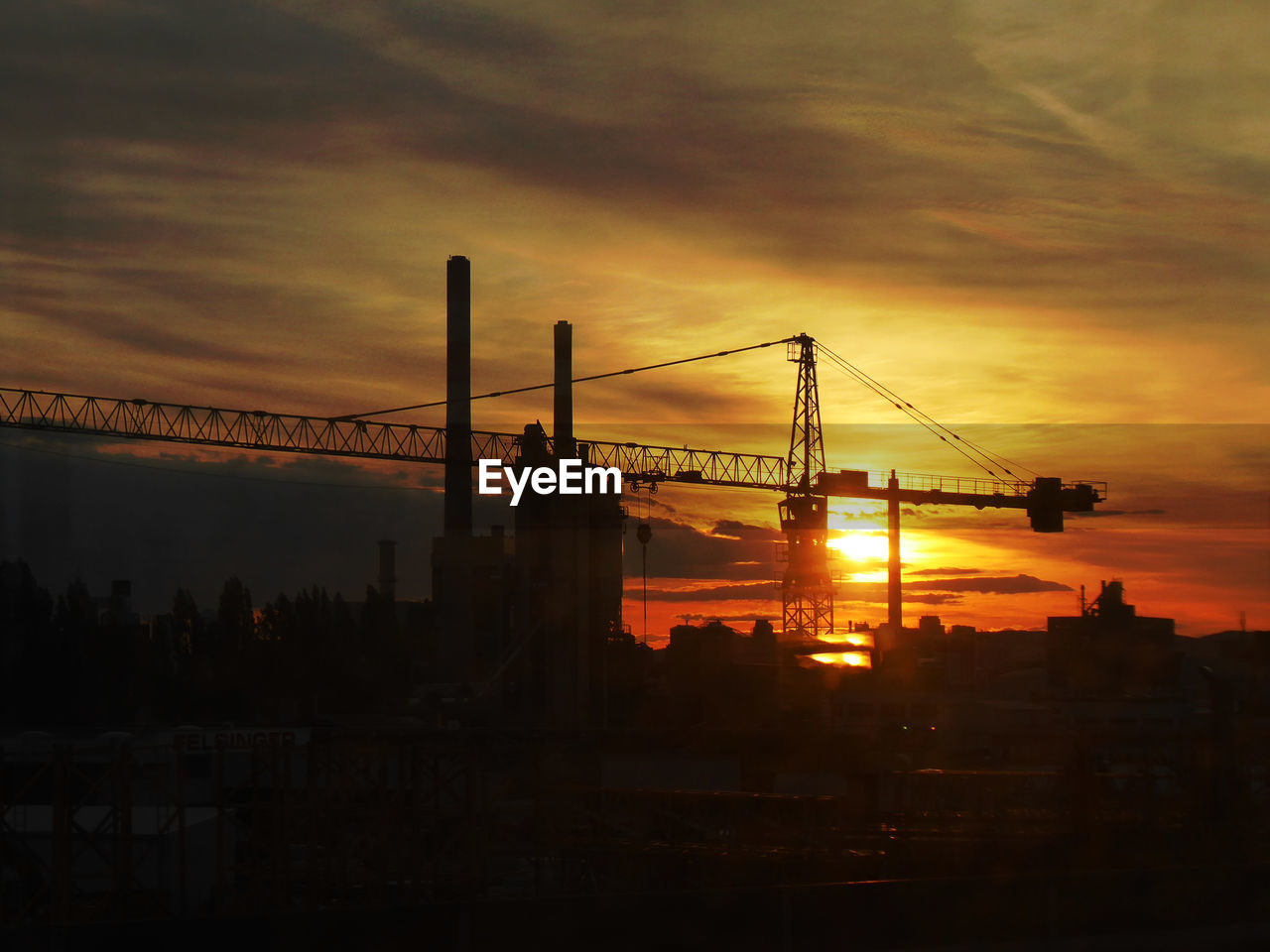 sunset, sky, cloud - sky, industry, orange color, built structure, construction site, machinery, construction industry, architecture, silhouette, nature, crane - construction machinery, sun, no people, development, building exterior, outdoors, incomplete, beauty in nature, construction equipment
