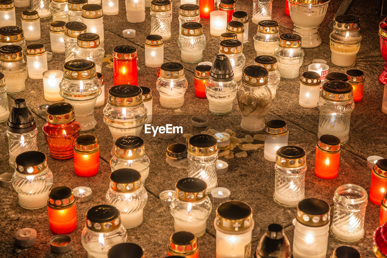 High Angle View Of Illuminated Candles On Floor