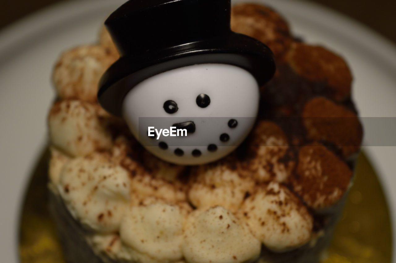 High Angle View Of Snowman On Dessert