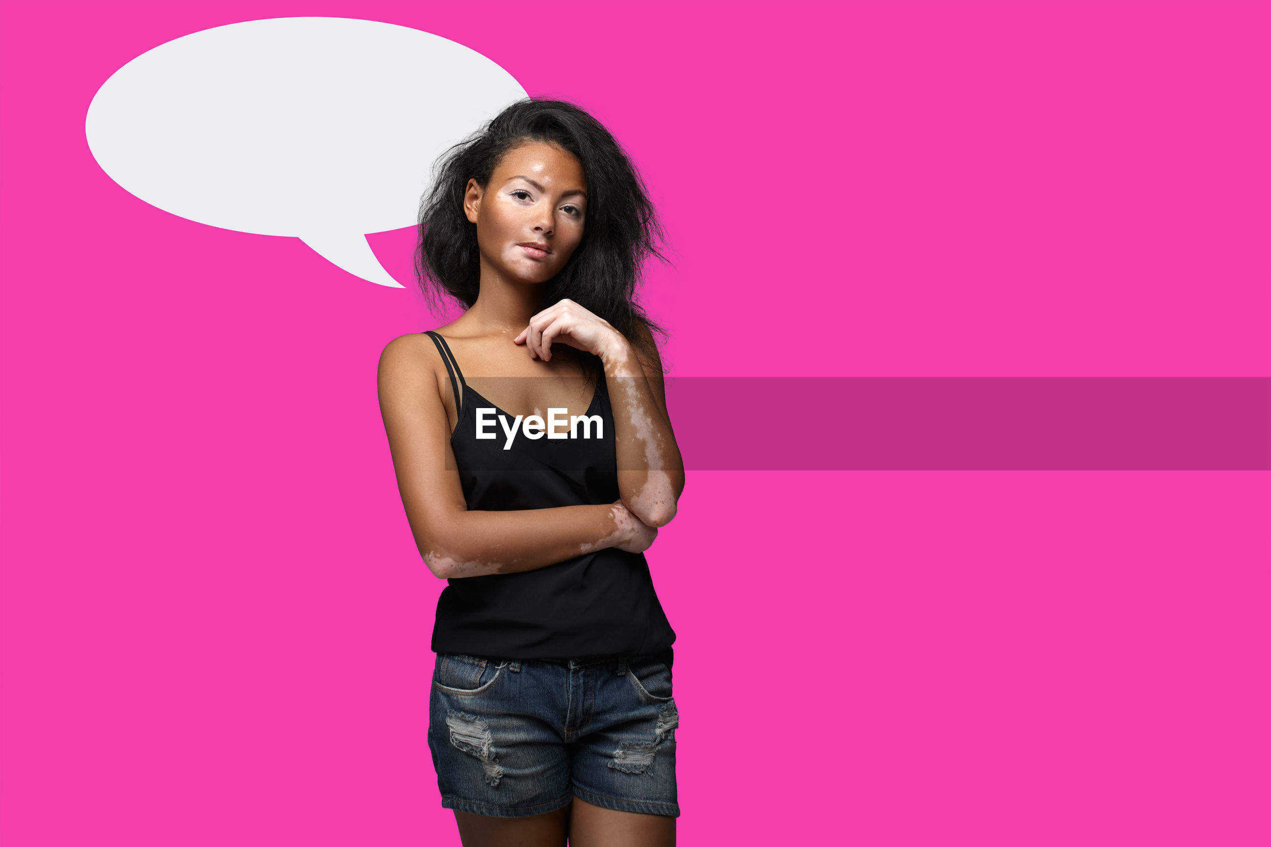 Portrait young woman standing speech bubble on pink background