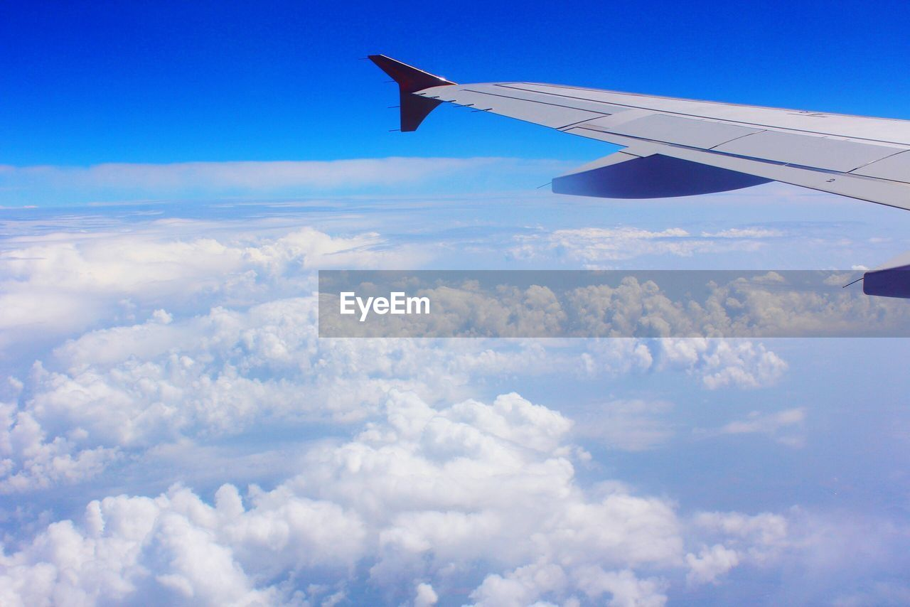 airplane, air vehicle, cloud - sky, sky, flying, transportation, mode of transportation, aircraft wing, beauty in nature, no people, travel, nature, scenics - nature, day, motion, mid-air, blue, public transportation, cloudscape, outdoors, above