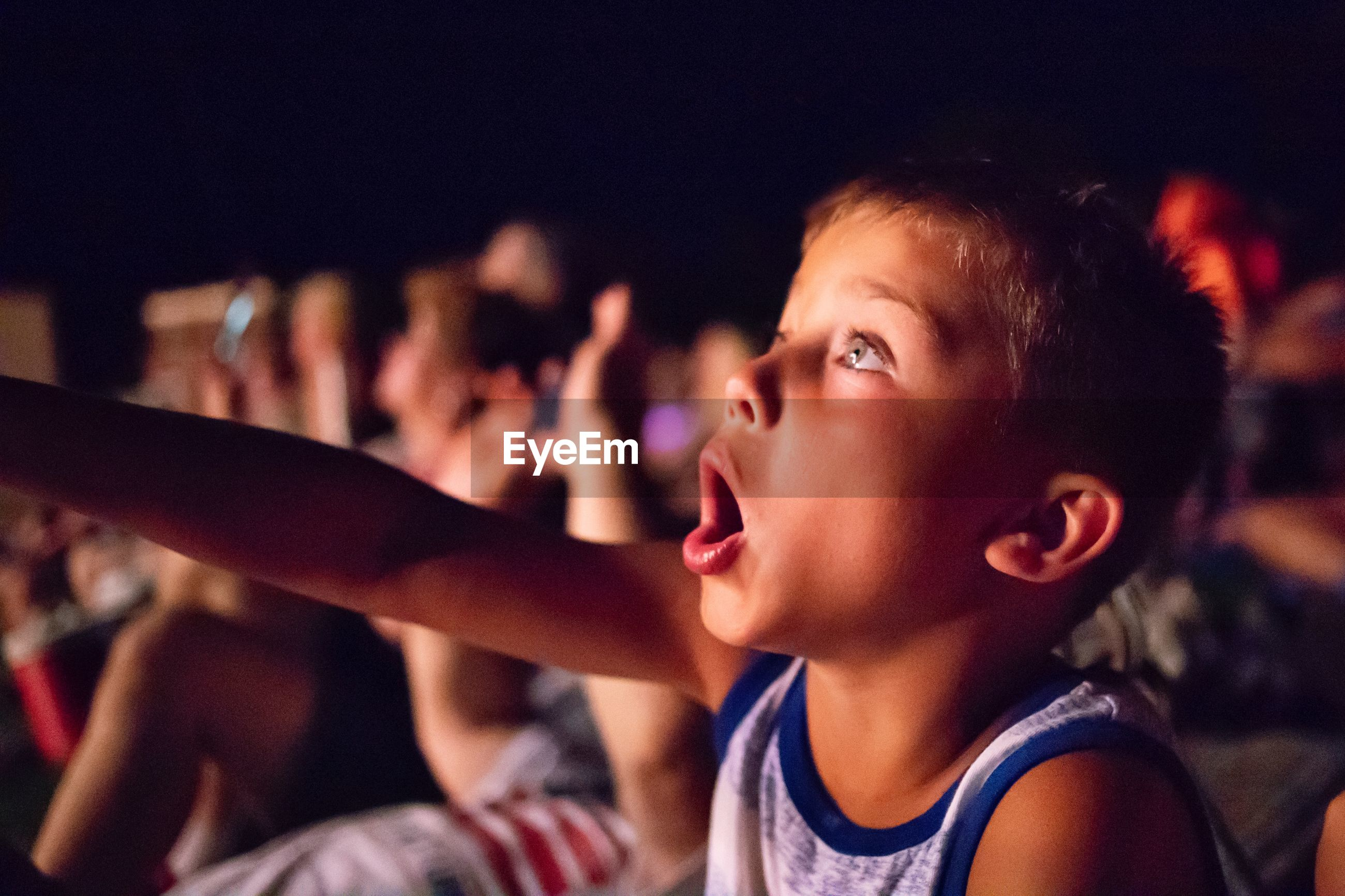 Boy watching movie in theater