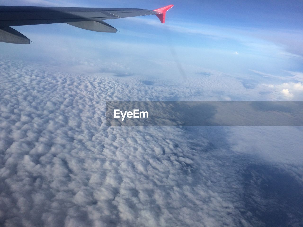 airplane, aerial view, transportation, flying, journey, airplane wing, aircraft wing, air vehicle, nature, mode of transport, no people, travel, mid-air, sky, beauty in nature, cloud - sky, day, landscape, scenics, outdoors, vehicle part, cold temperature