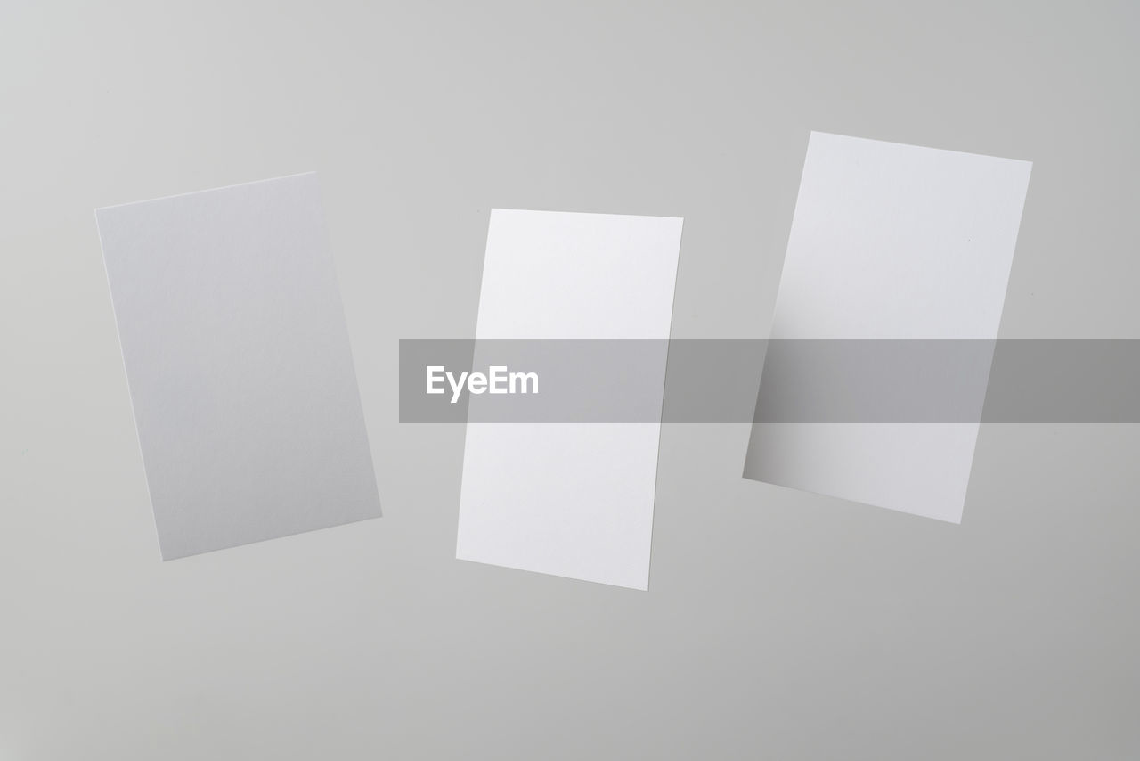 blank, paper, copy space, white color, indoors, no people, white background, studio shot, empty, still life, close-up, cut out, shape, geometric shape, high angle view, white, group of objects, design, communication, directly above, message