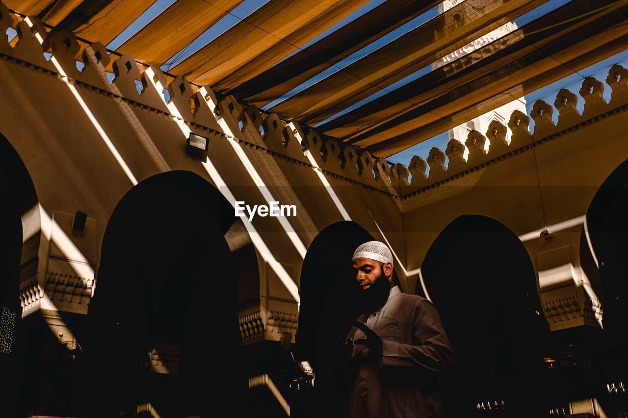 Man standing in mosque