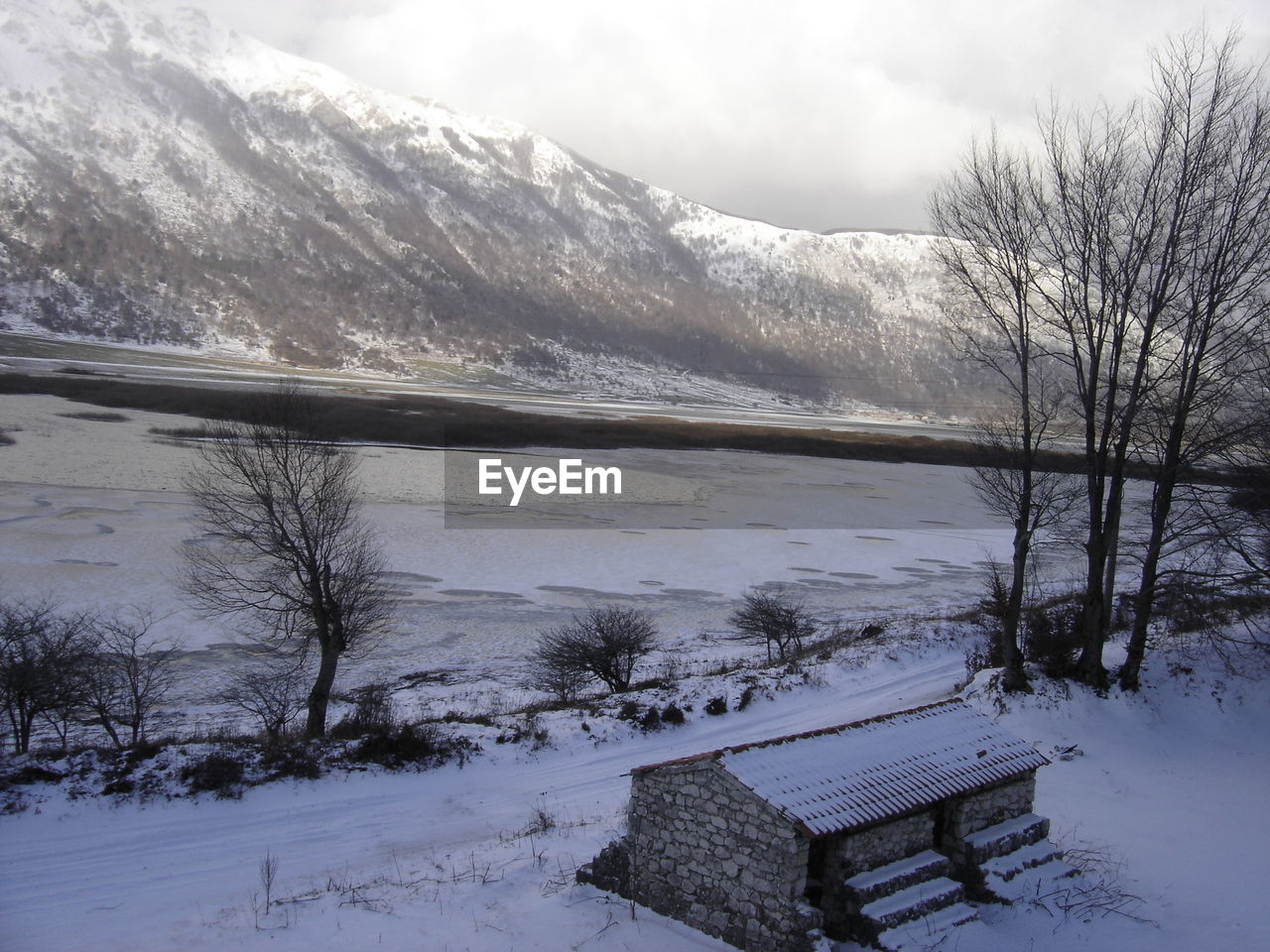 snow, winter, cold temperature, weather, nature, beauty in nature, cold, tranquility, scenics, landscape, tranquil scene, mountain, no people, outdoors, day, water, sky, scenery, bleak