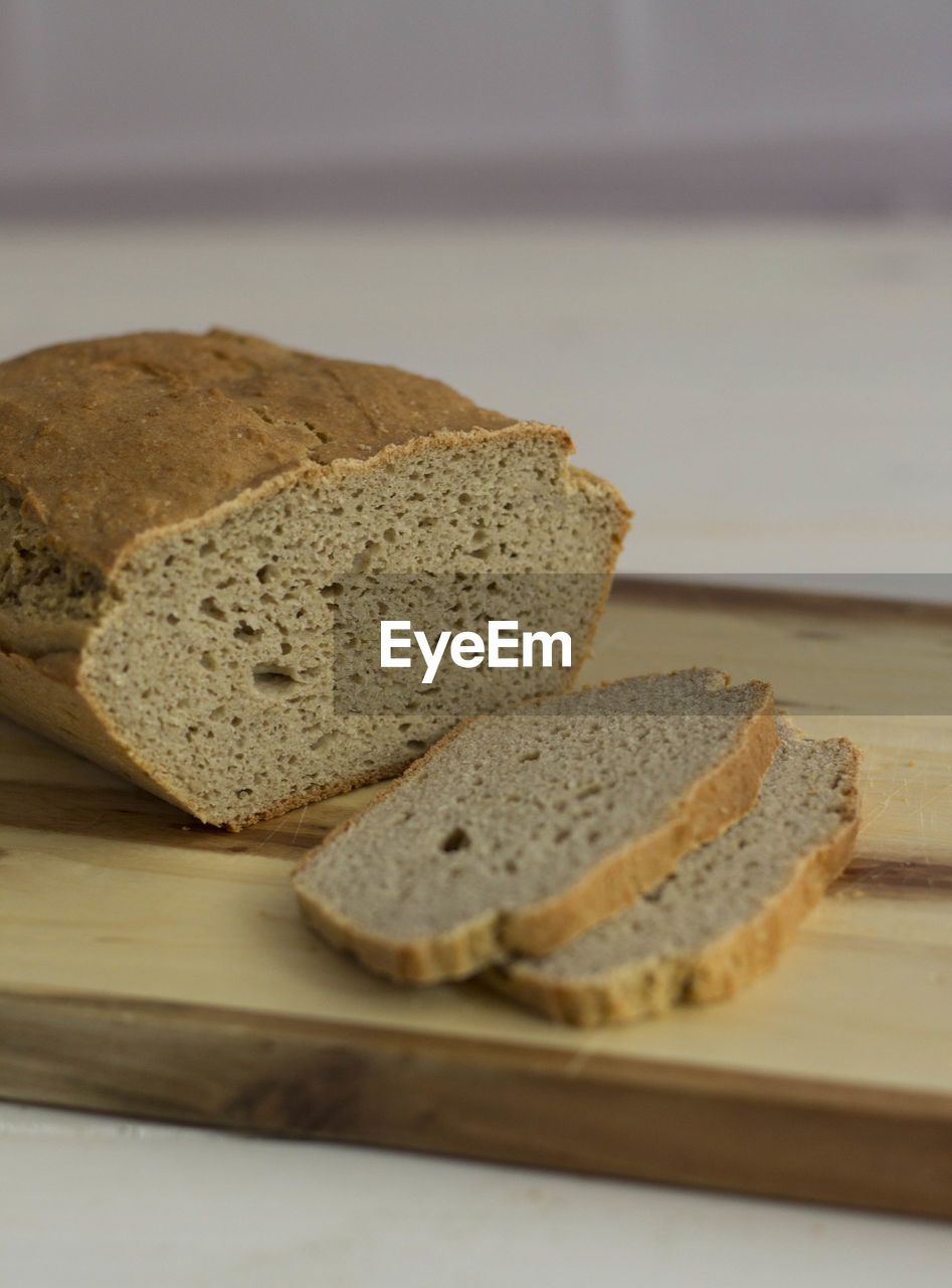 View Of Loaf Of Brown Bread With Two Slices