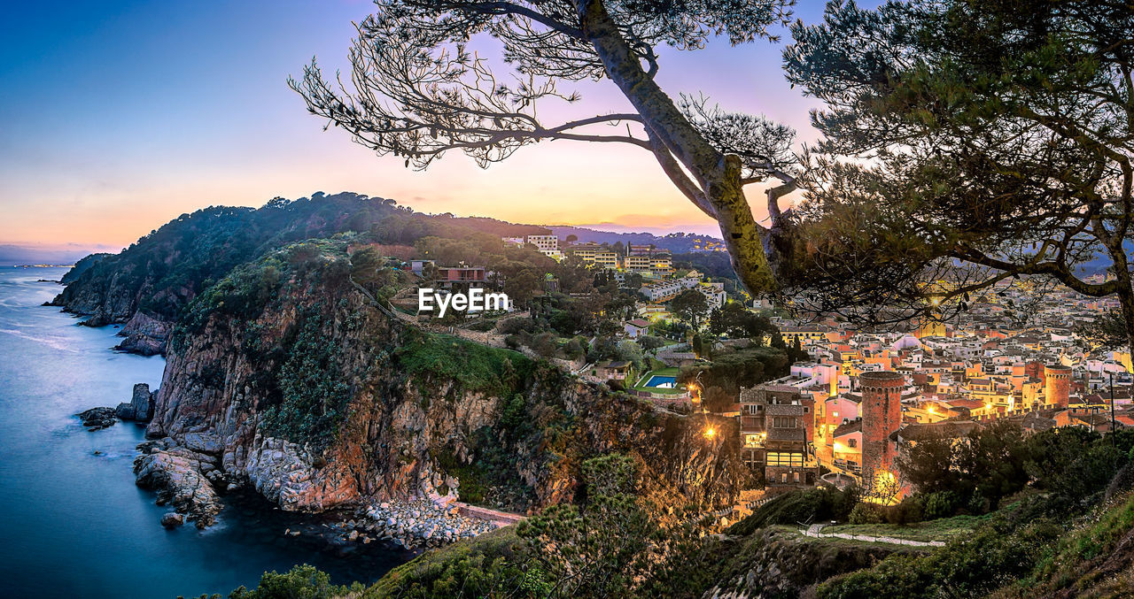 tree, building exterior, architecture, built structure, plant, sky, nature, building, city, water, beauty in nature, residential district, mountain, no people, scenics - nature, town, sunset, high angle view, outdoors, cityscape, townscape