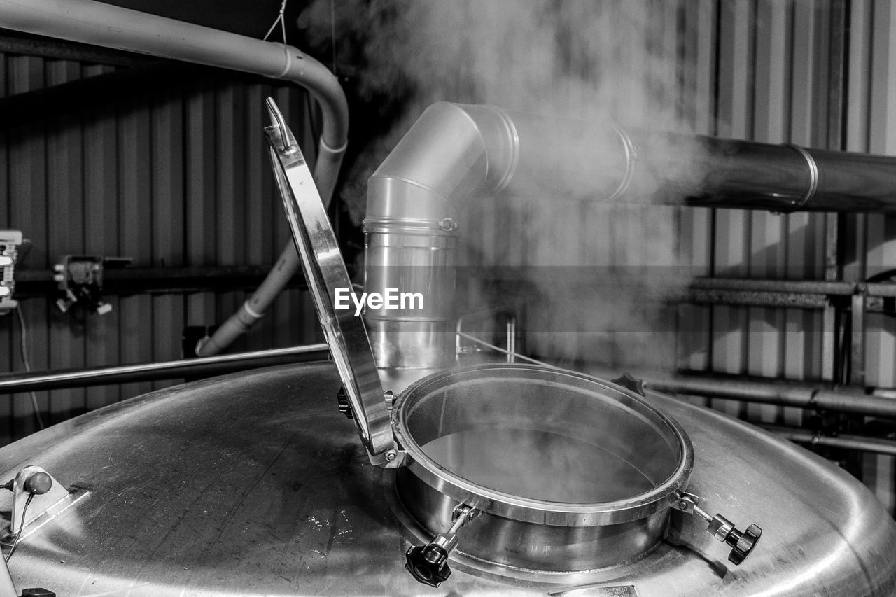 motion, indoors, no people, water, focus on foreground, household equipment, close-up, faucet, metal, industry, kitchen, steam, factory, pouring, nature, domestic room, day, domestic kitchen, blurred motion, steel