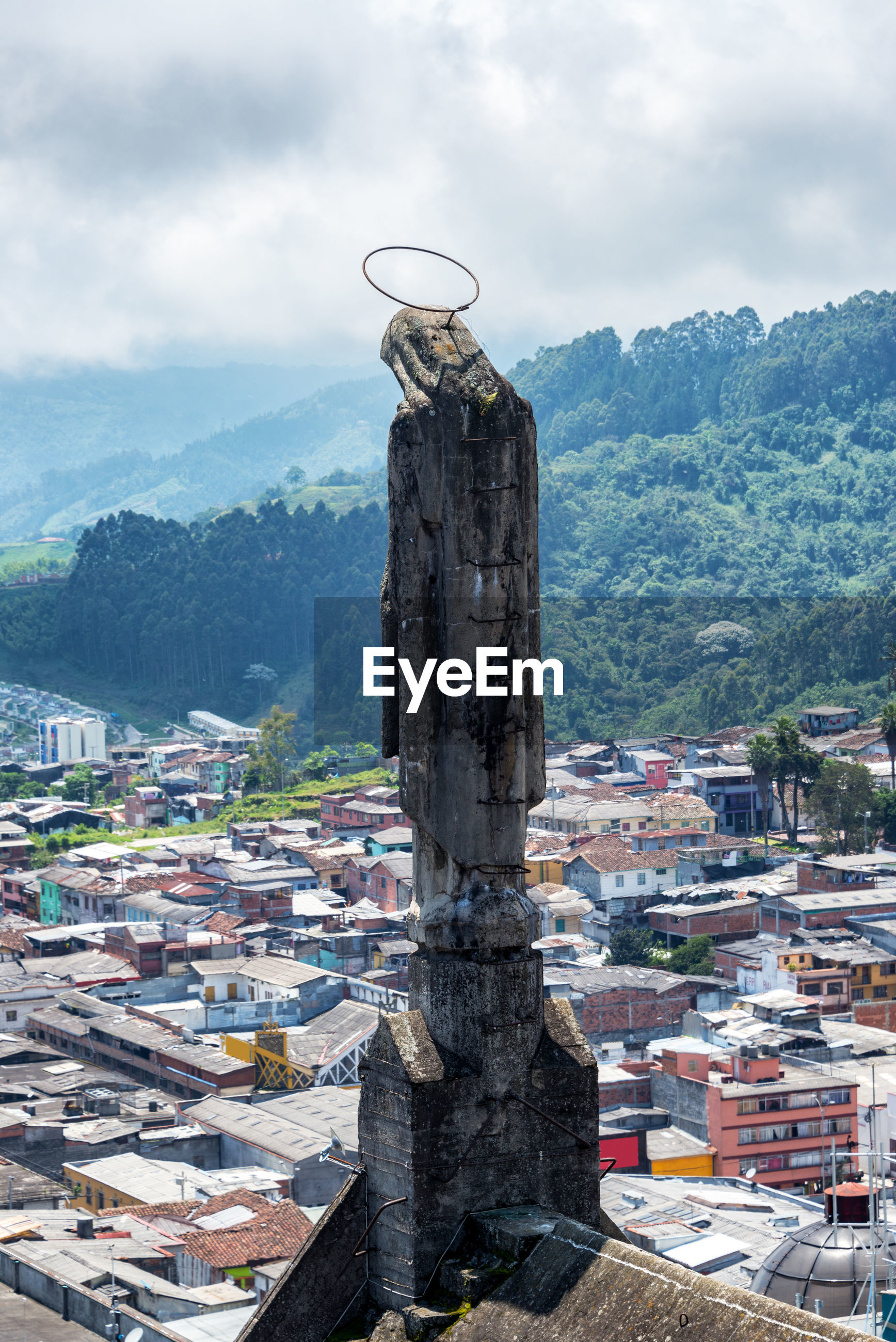 Statue on manizales cathedral in city against sky